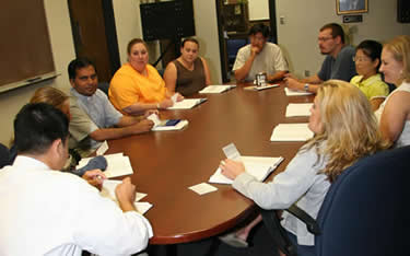 students at conference table.jpg