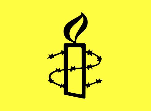 Amnesty International's yellow candle logo