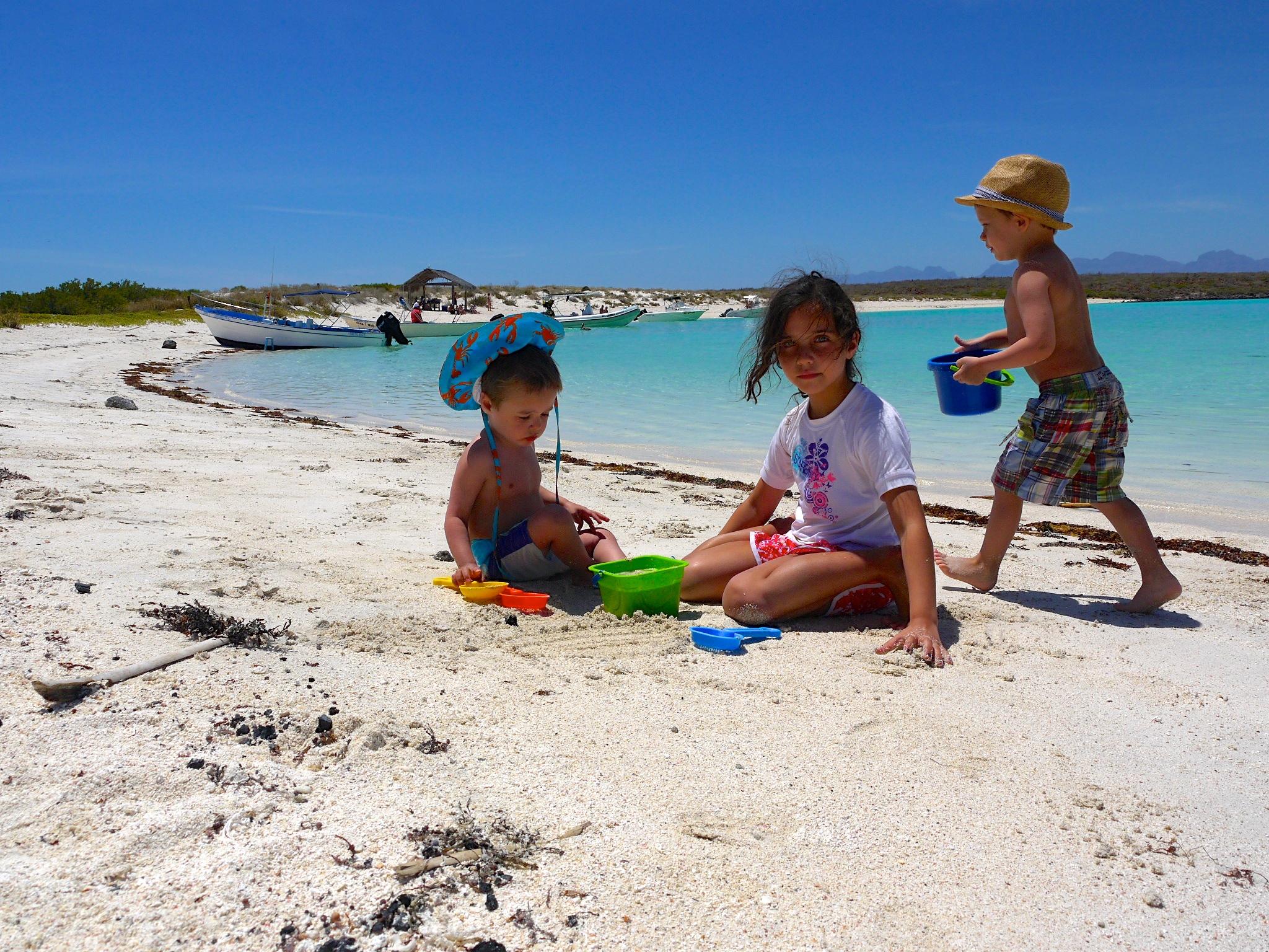 Everett (and his goofy sun hat), Madeline, and Elliott hard at work building castles on Coronado Island.