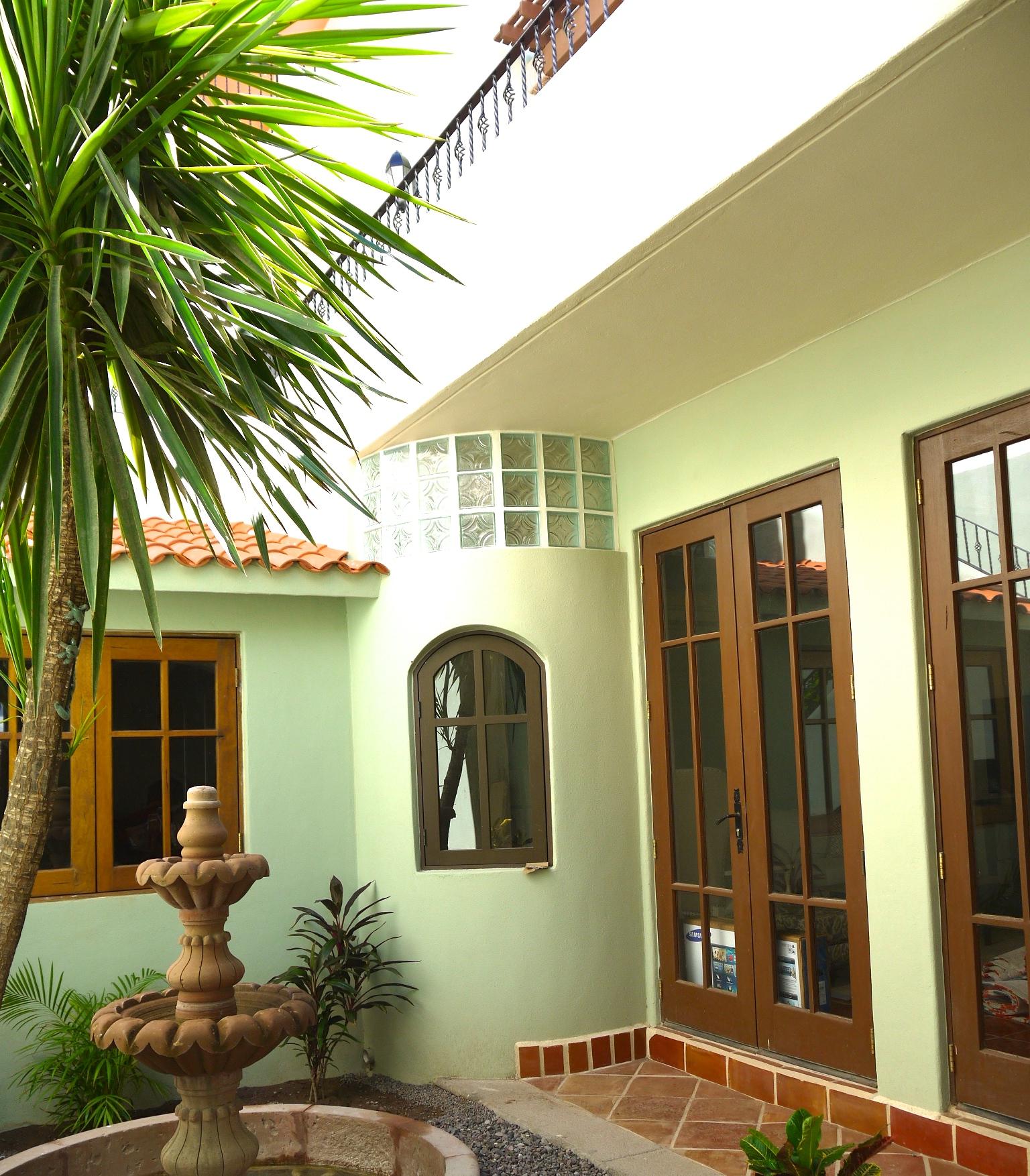 Private garden courtyard, doors leading to main floor interior
