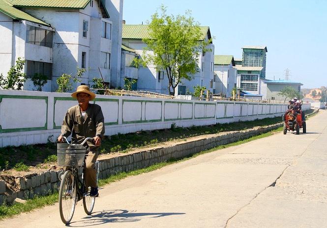 north-korean-farm-man-bike.jpg