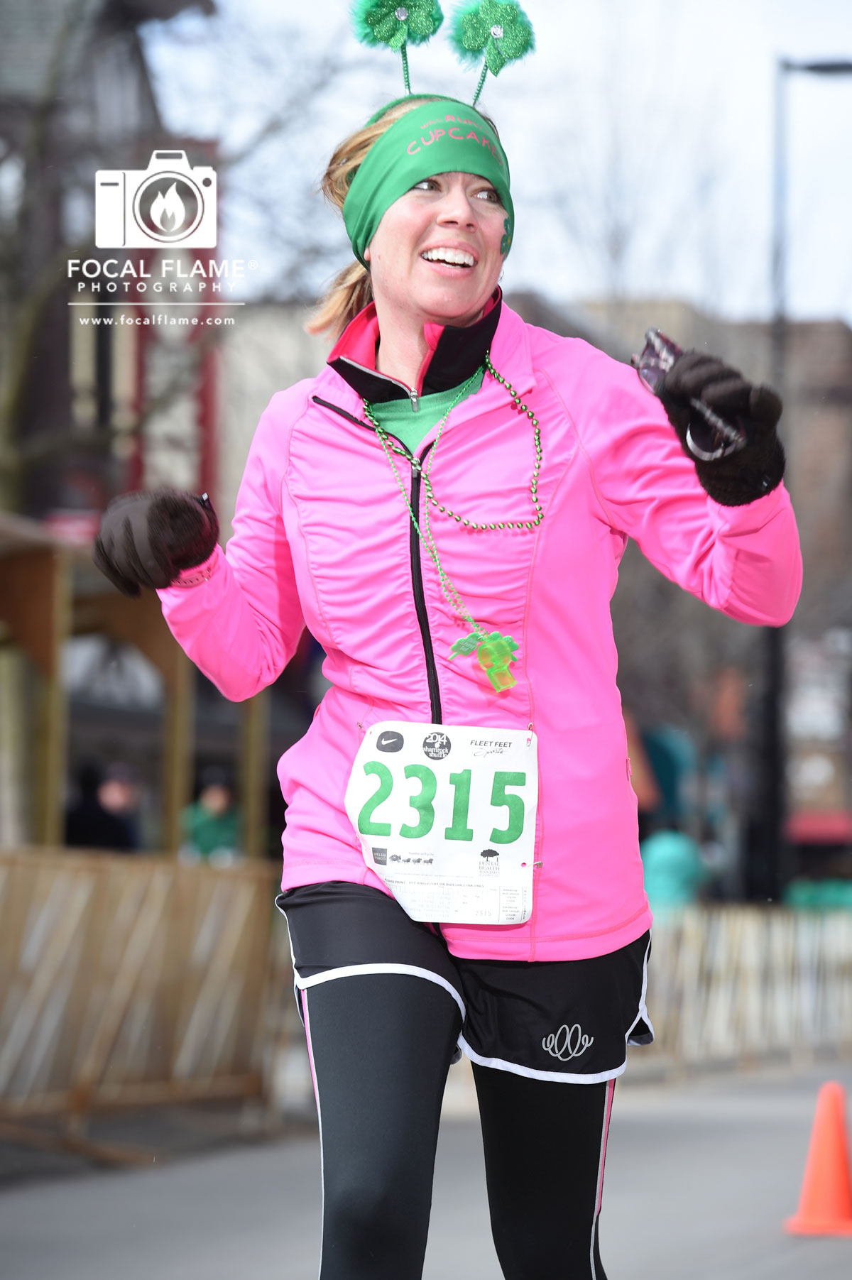 Krissy Schintgen rocks the 2014 Madison Shamrock Shuffle, sporting a brilliant smile despite high winds and cold temperatures. Photo credit: Clint Thayer, Focal Flame Photography