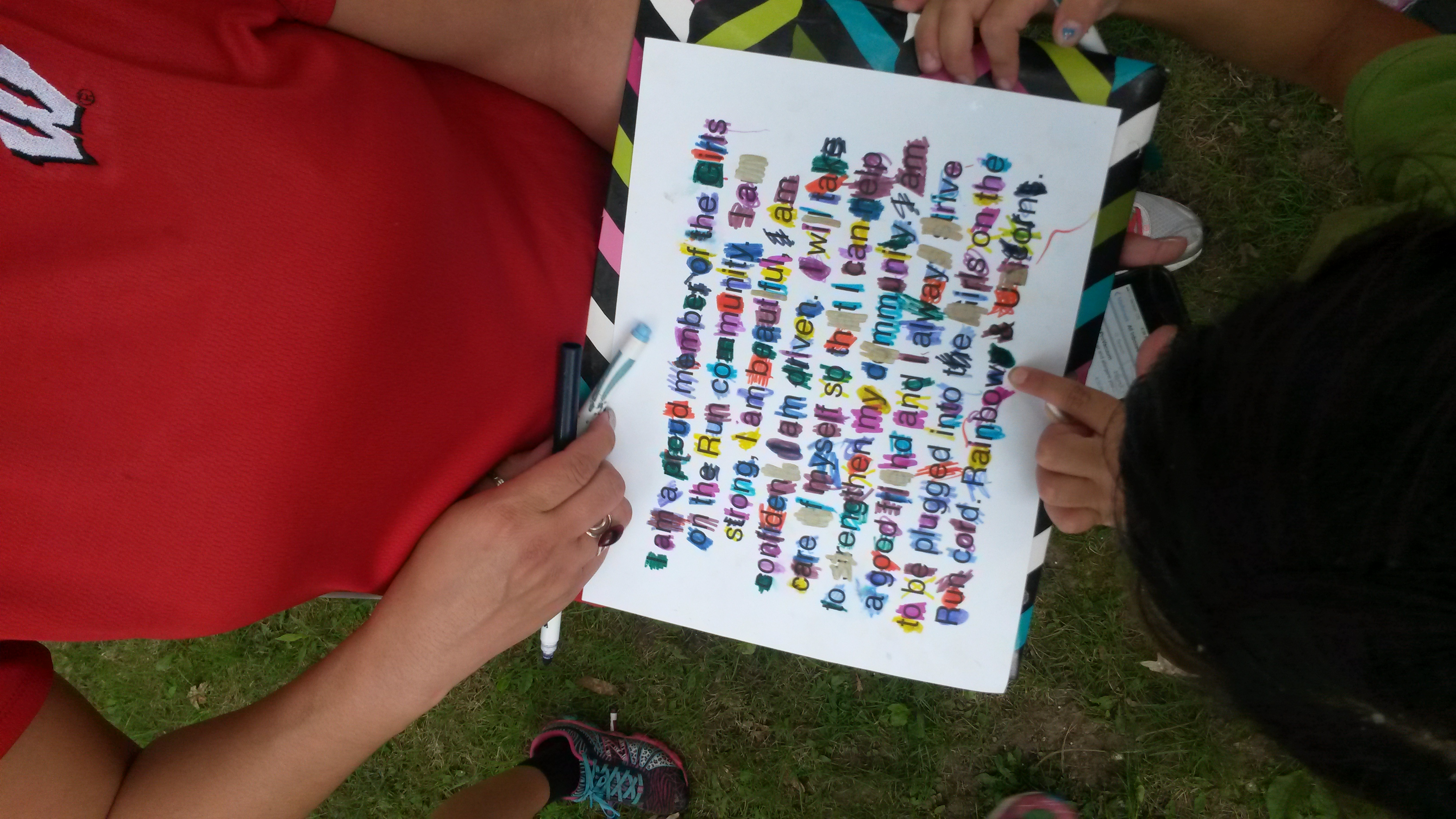 GIrls on the Run coach Meredith Rhodes Carson, a health coach with From This Day Forward Health Coaching, uses a message to help girls complete about 224 laps around a school yard. For every lap they completed they crossed off a letter in the statement.