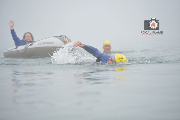 The swim is a team effort, with Care2Tri members taking turns pulling an inflatable vessel carrying another member. © 2014 Focal Flame Photography | Photo credit: Austin Cope