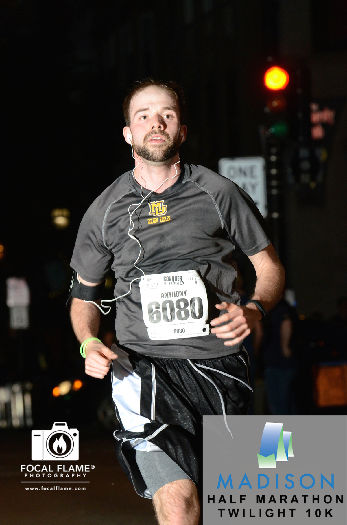 On May 24, Anthony Garcia ran the Madison Marathon Twilight 10K, racing through the downtown streets at nightfall. © 2014 Focal Flame Photography   Photo credit: Paul McMahon