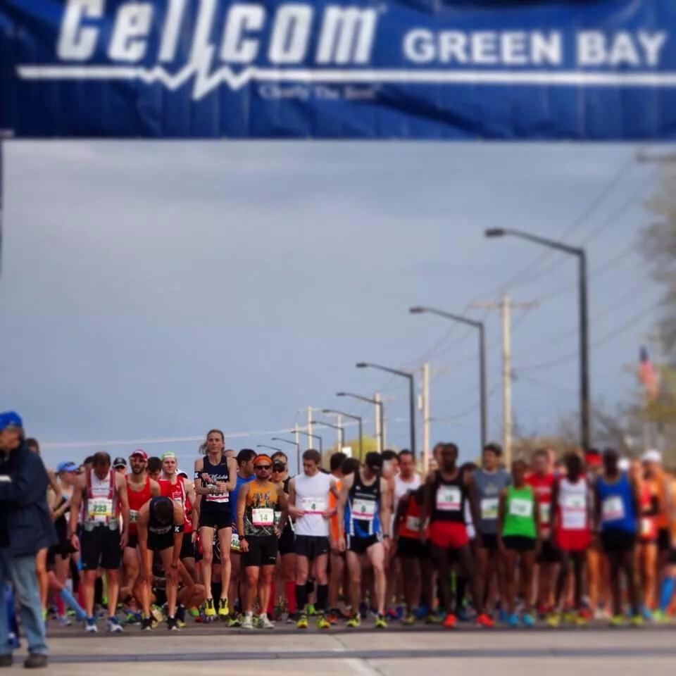 Emily Kurian (left-center, jumping) at the Green Bay Marathon. Credit: David Mari