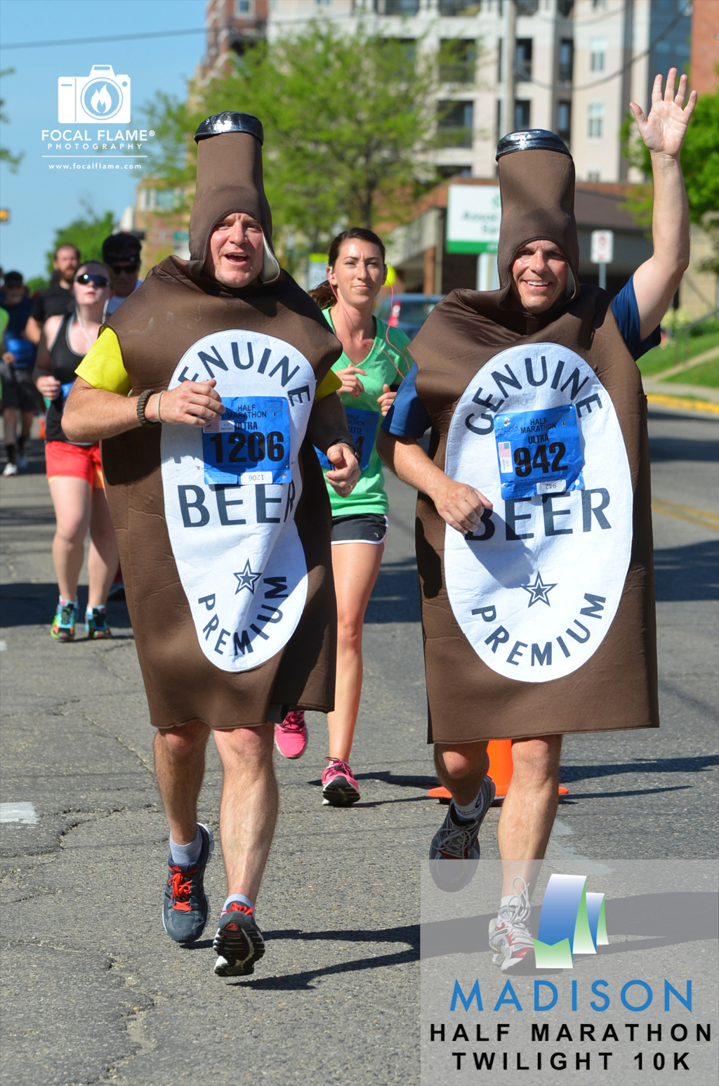 Mich and Ultra, otherwise known as Bill Enright (left) and Brent Kimbel (right), wave to fans during the 2014 Spring Madison Half Marathon. © 2014 Focal Flame Photography