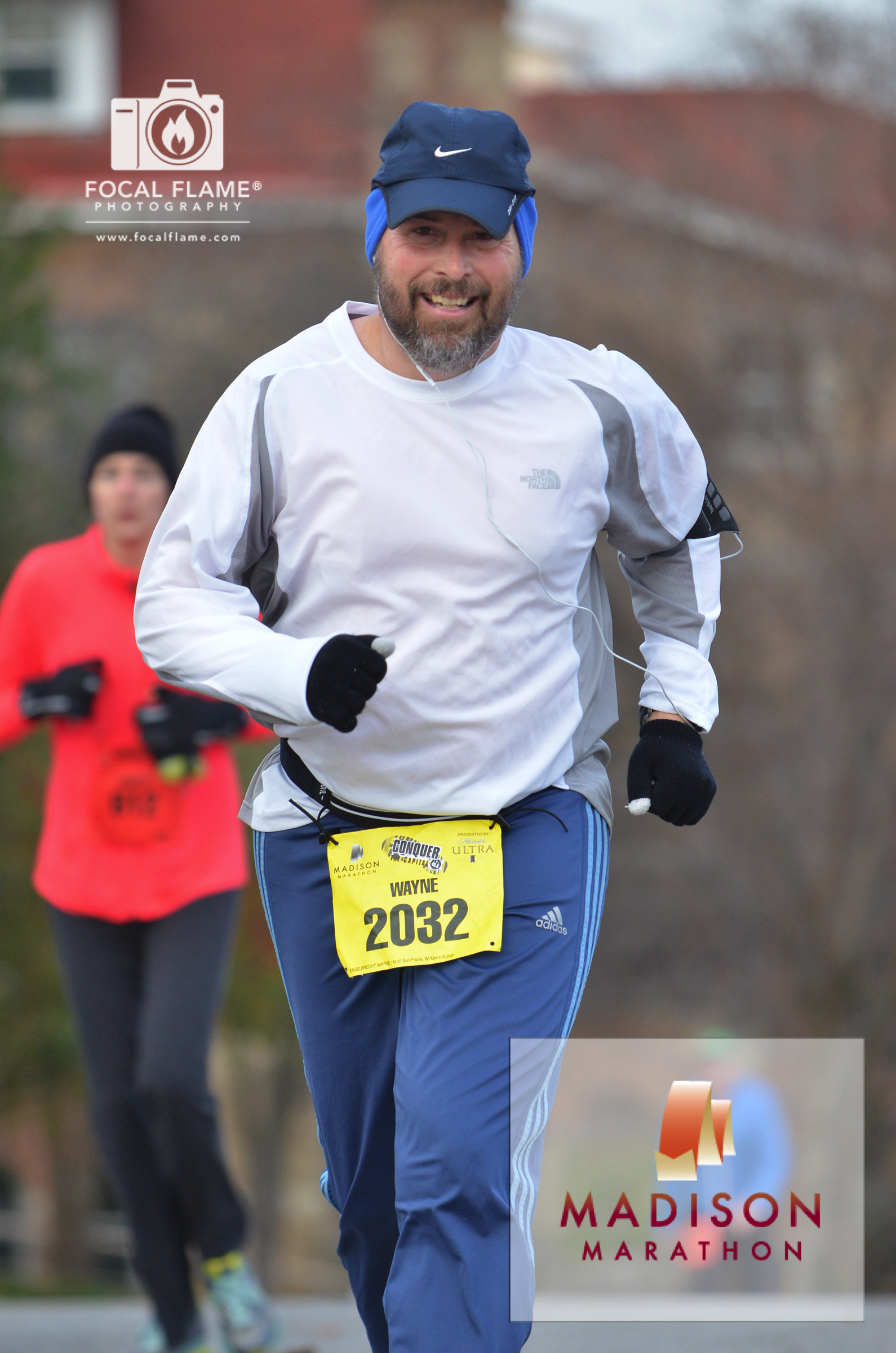 Wayne Enbelbrecht runs the 2014 Madison Fall Marathon. He has volunteered to help support the race for the past 10 years. © 2014 Focal Flame Photography | Photo credit: Austin Cope