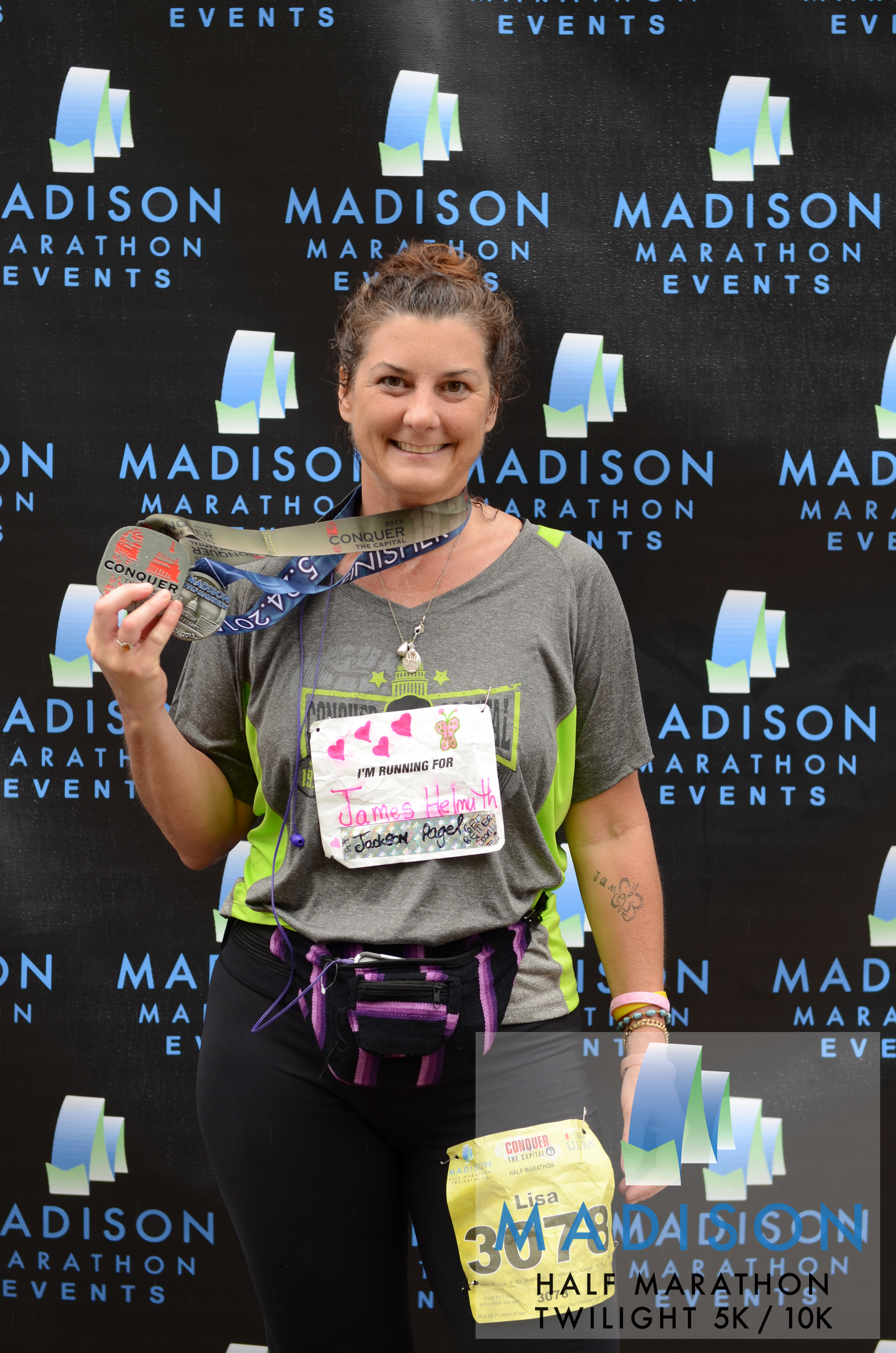 "Lisa celebrates finishing the spring 2015 Madison Half Marathon. She also ran the Twilight 10K the evening beforehand, a combination called ""Conquer the Capitol."" © 2015 Focal Flame Photography 