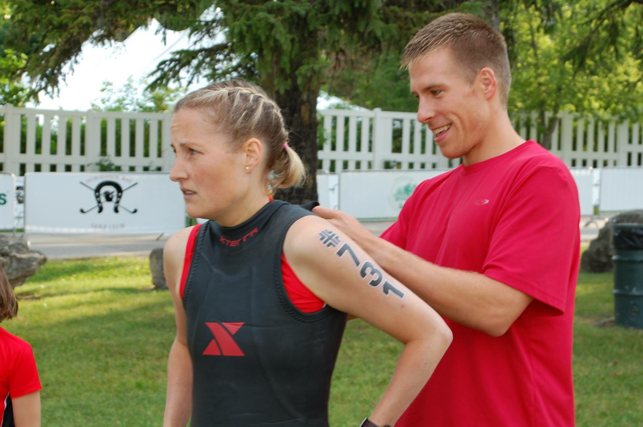 Krista getting pre-race assistance from her husband. Photo courtesy of Krista Willing.