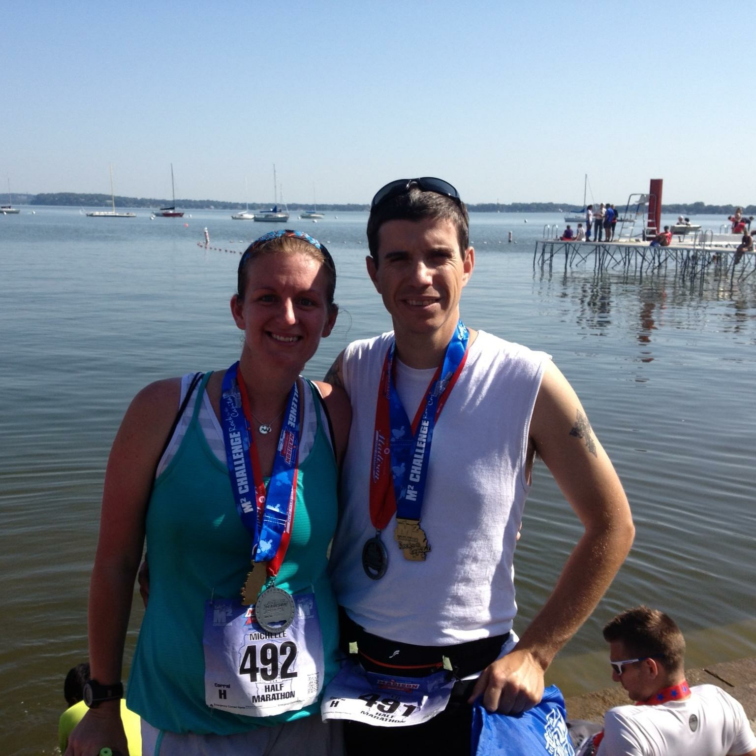 Michelle and Ed show off their medals after a race in Madison in 2013. Photo courtesy of Michelle Poelsterl.