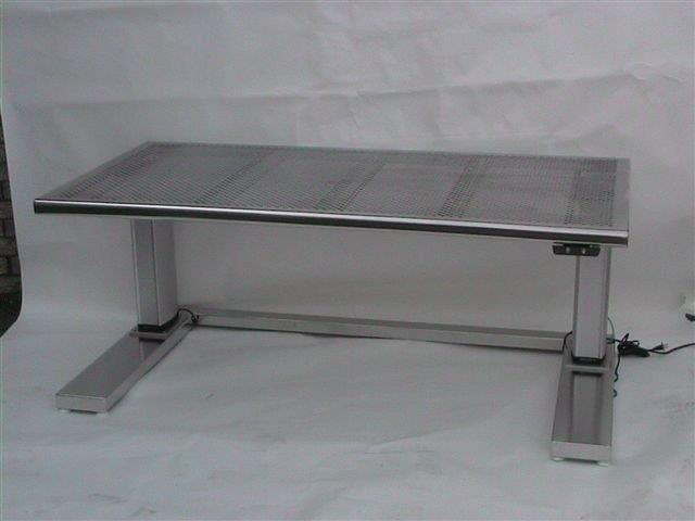 Custom perforated tabletop for cleanroom environments.