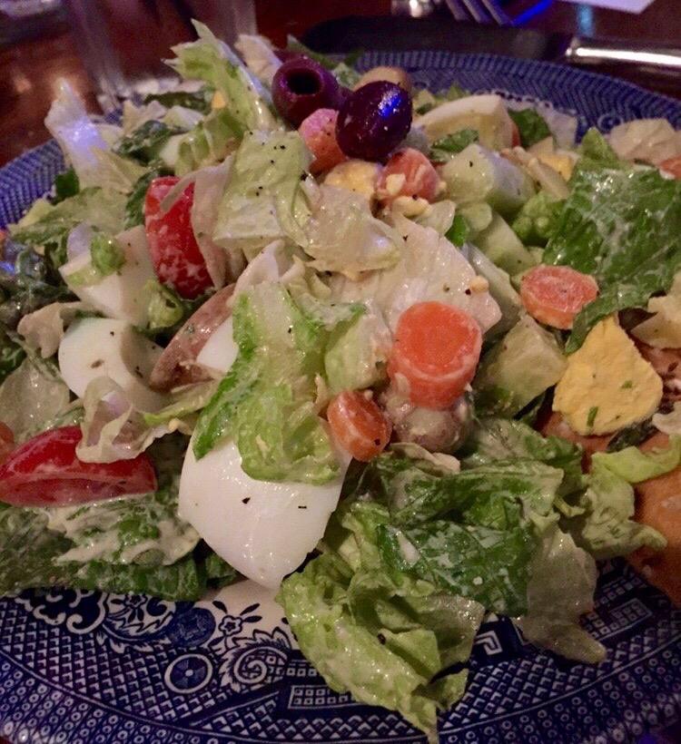 Goddess Salad  with Vine Tomato, Carrot, Cucumber, Seasonal Fruit, Kalamatas, Hard Boiled Egg, Pearl Potato, Smoked Gouda,Homemade Green Goddess Dressing & Freshly Cracked Pepper!