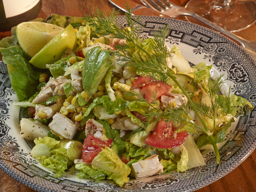 Grilled Chopped Salad including your choice of Grilled All-Natural Chicken or Grilled Wild Caught Shrimp, with Grilled Zucchini & Corn, Fresh Cold Greens, Vine Tomato, Avocado, Seasonal Fruit tossed in Homemade Champagne-Lime Vinaigrette