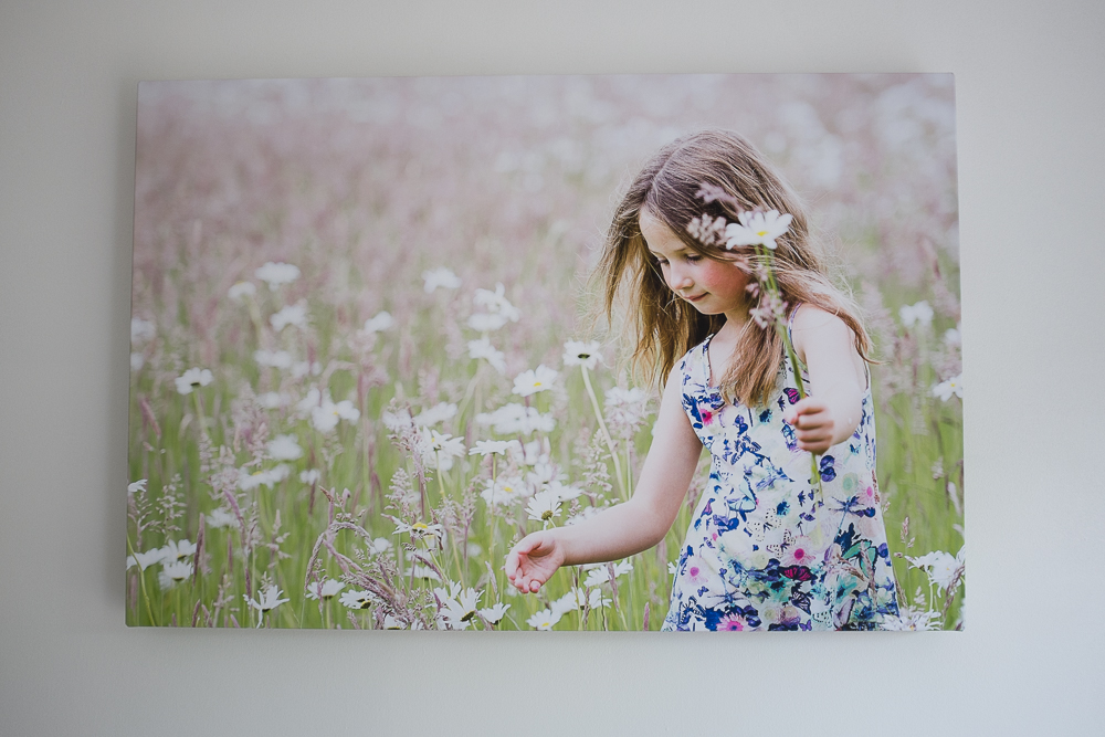 For Jorja, I chose this candid portrait because it captures her personality perfectly.  She has a whimsical nature and adores picking flowers.
