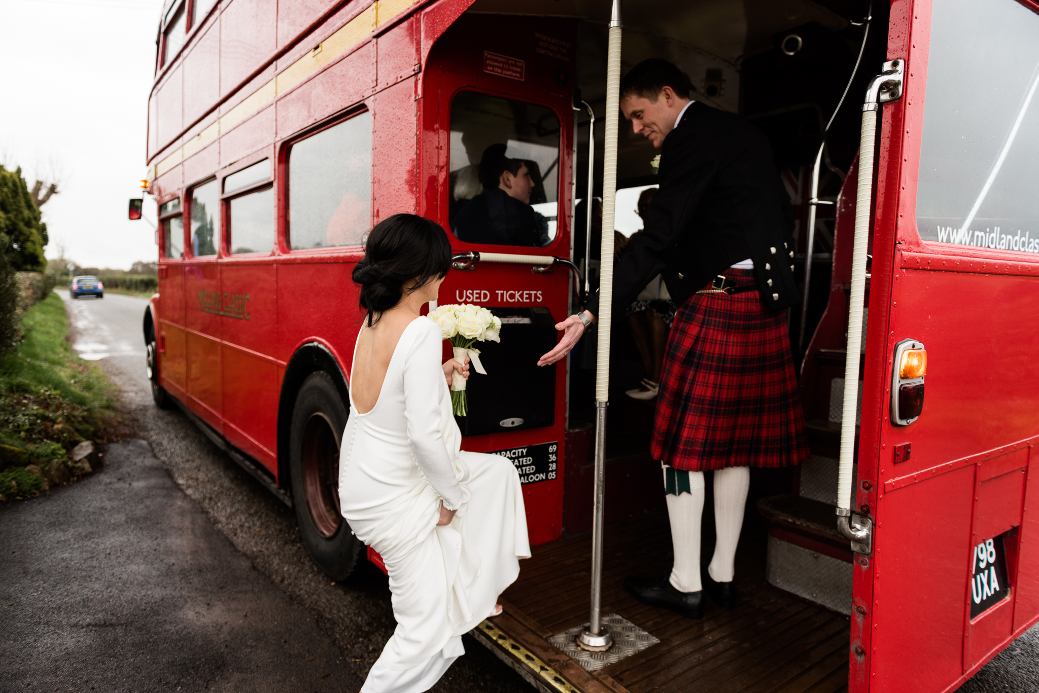 English Winter Wedding Photography at Somerford Hall, Staffordshire Red Bus Double Decker Kilts Bagpiper-36.jpg