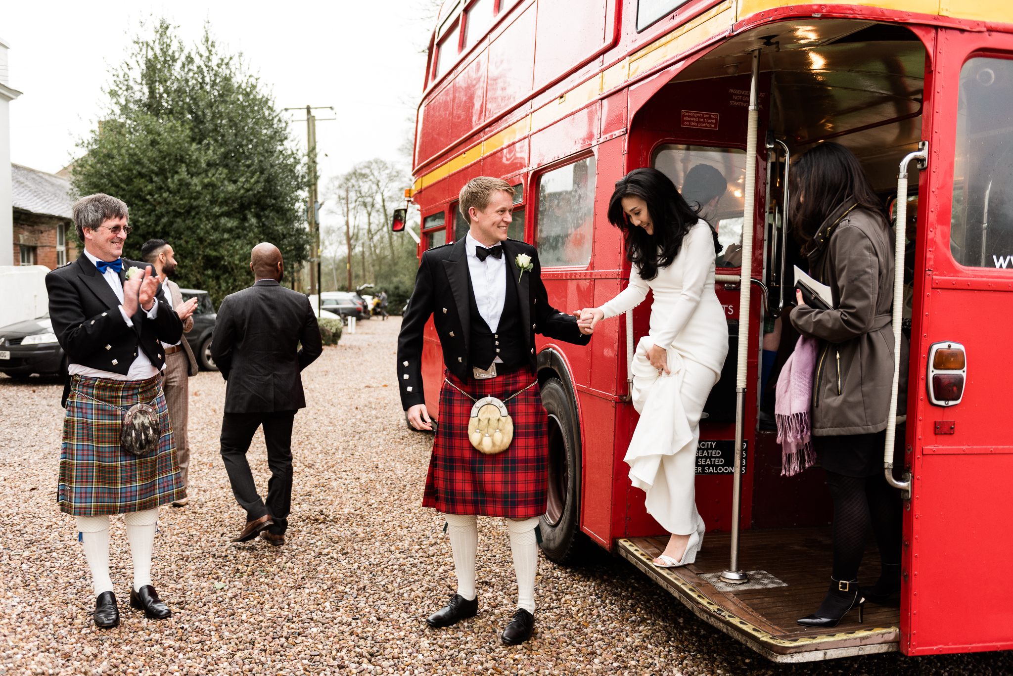 English Winter Wedding Photography at Somerford Hall, Staffordshire Red Bus Double Decker Kilts Bagpiper-39.jpg