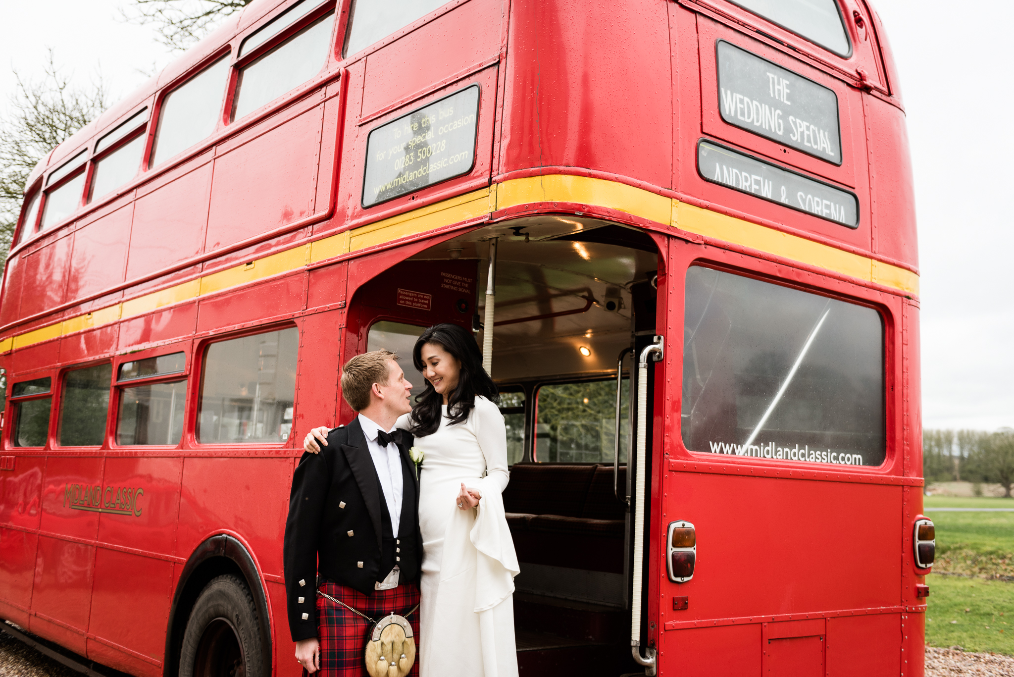 English Winter Wedding Photography at Somerford Hall, Staffordshire Red Bus Double Decker Kilts Bagpiper-41.jpg