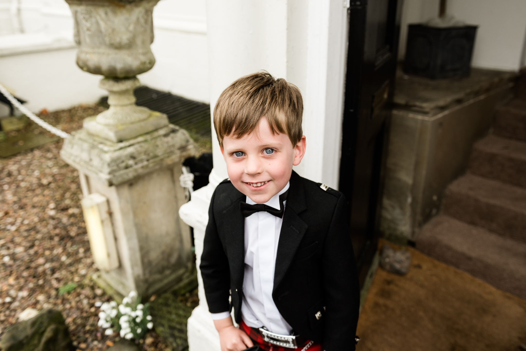 English Winter Wedding Photography at Somerford Hall, Staffordshire Red Bus Double Decker Kilts Bagpiper-52.jpg