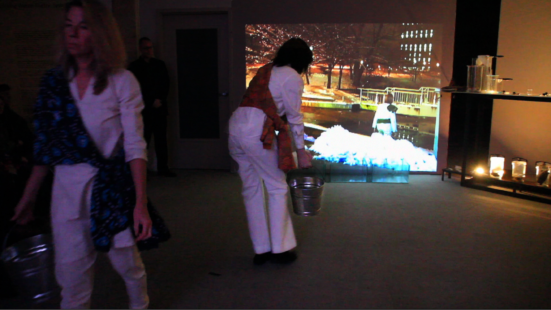 Mary Averill and Jessica Higgins (indoors) andLesley Farlow (outdoors in live feed video), performing Walking Water by David Teeple.