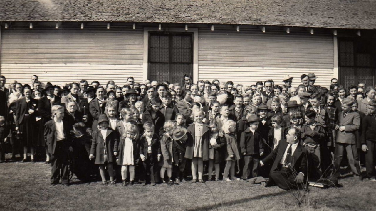 Bethel Temple Group Photo. Part 1. Pastor B. M. David sitting in foreground in dark suit and tie. This set of two photos were taken close to the time that B. M. David became the pastor. Note the group size and varied ages—both signs of a healthy church.