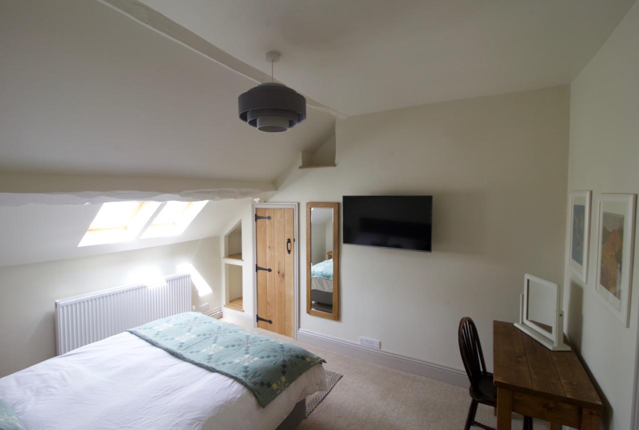 Room 7 bedroom TV end Coach House Norbury.jpg
