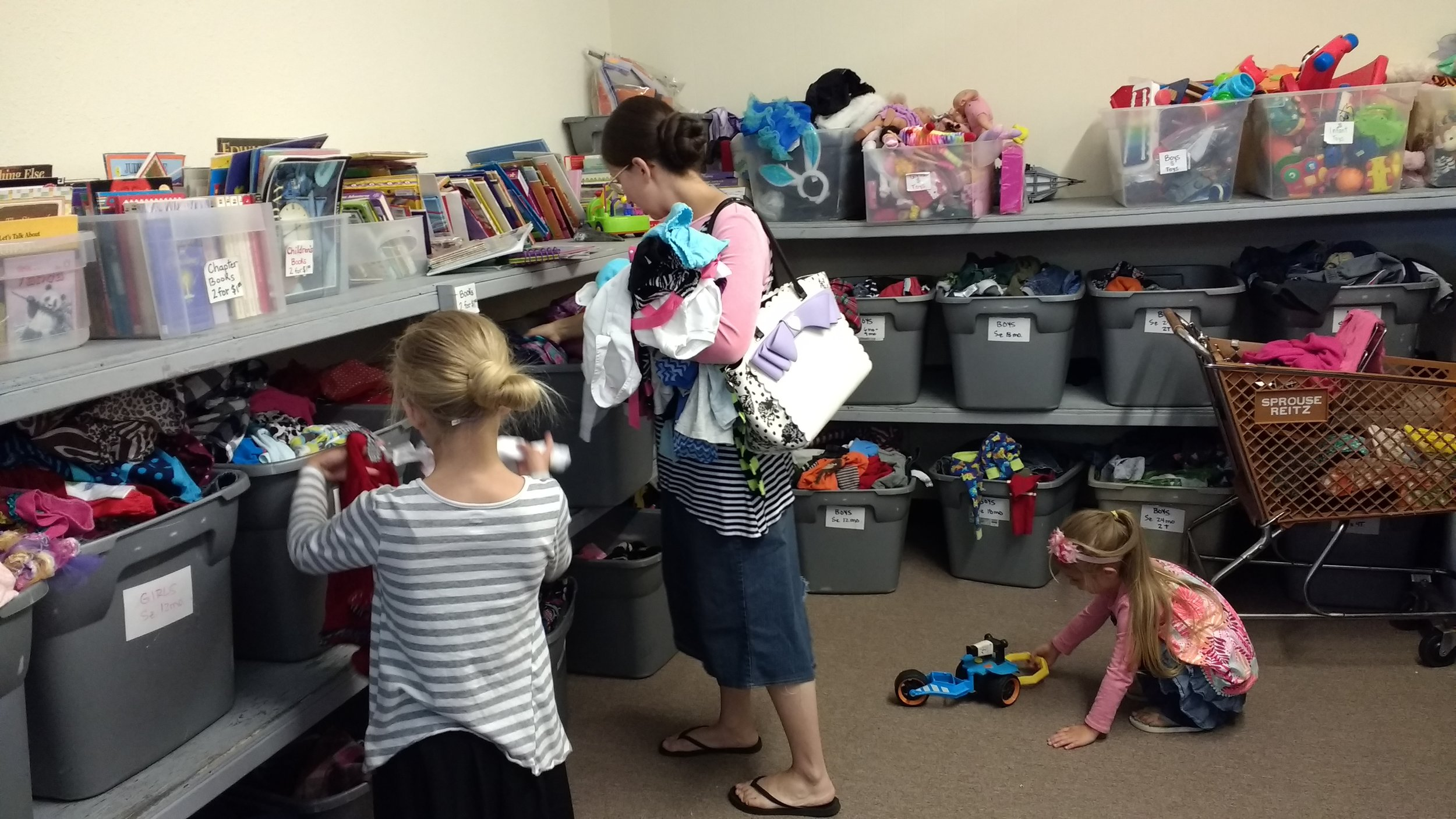 """Sis. Jennifer, Mandy and Megan finding good deals in the """"Dollar Room"""" at That Baby Store"""
