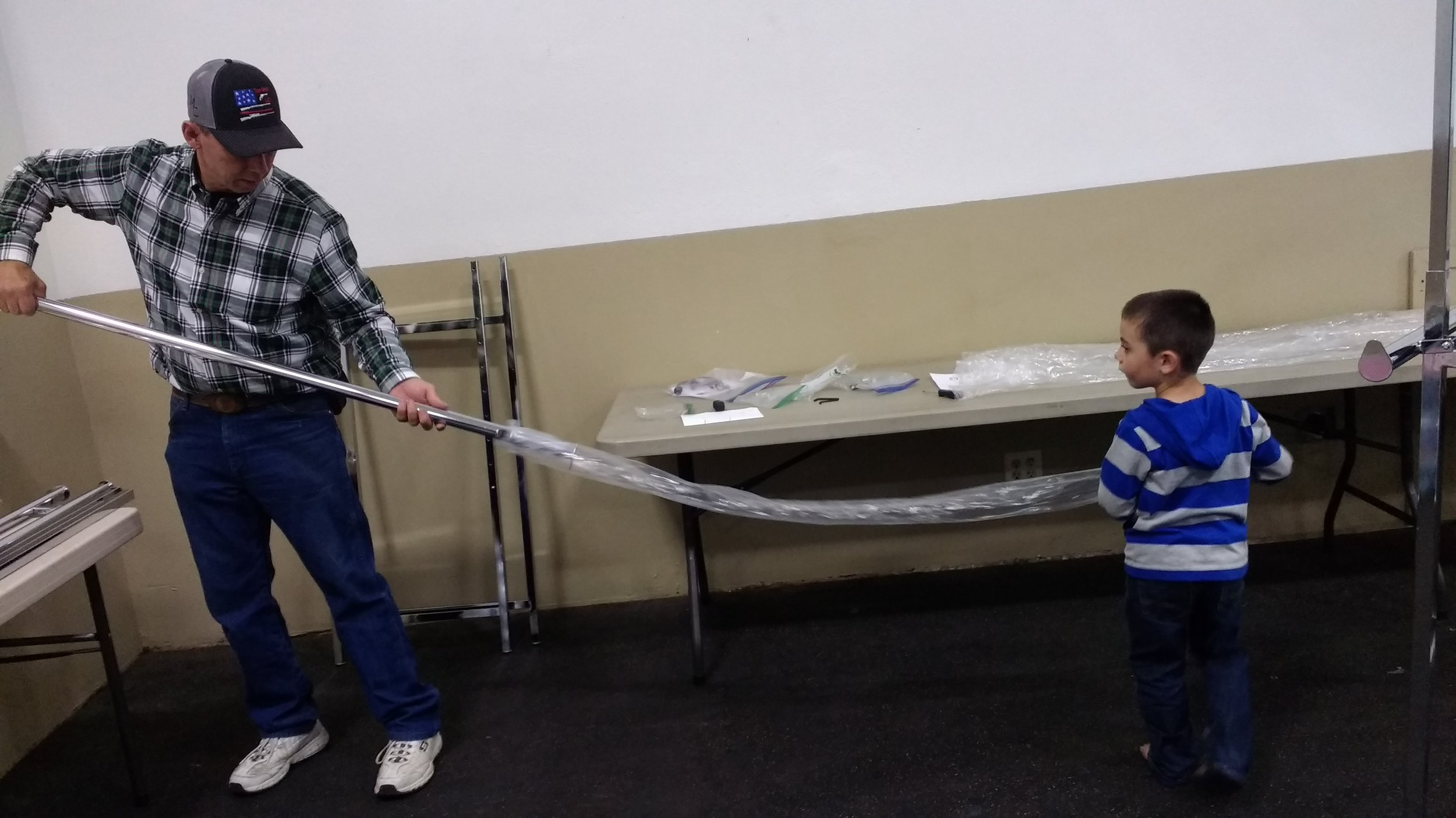 Bro. Mick and grandson Jared setting up our vendors area