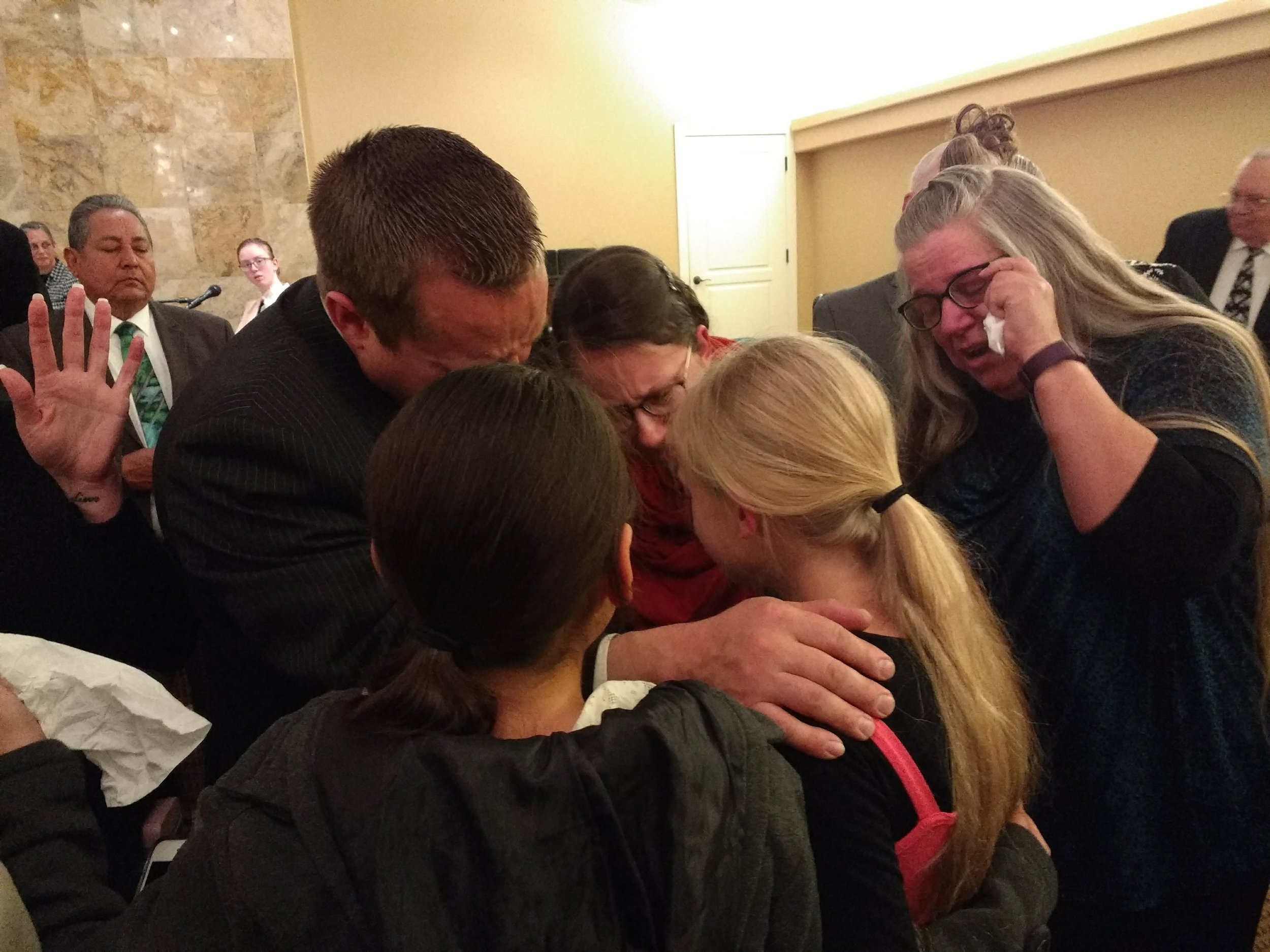 Bro. Matthew, Sis. Jen (parents) and Sis. Kathryn (grandma) praying with Emily