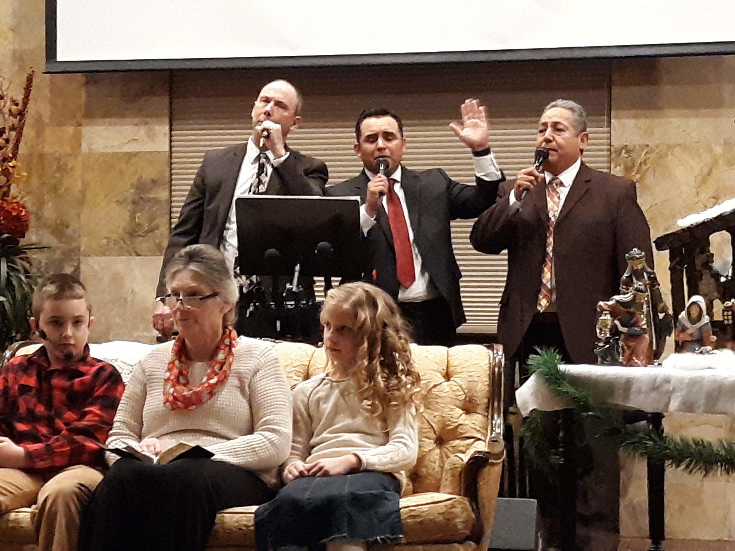 "Our men's trio - Bro. Mick, Bro. Raul and Bro. Nevarez sing ""Look who just checked in."""