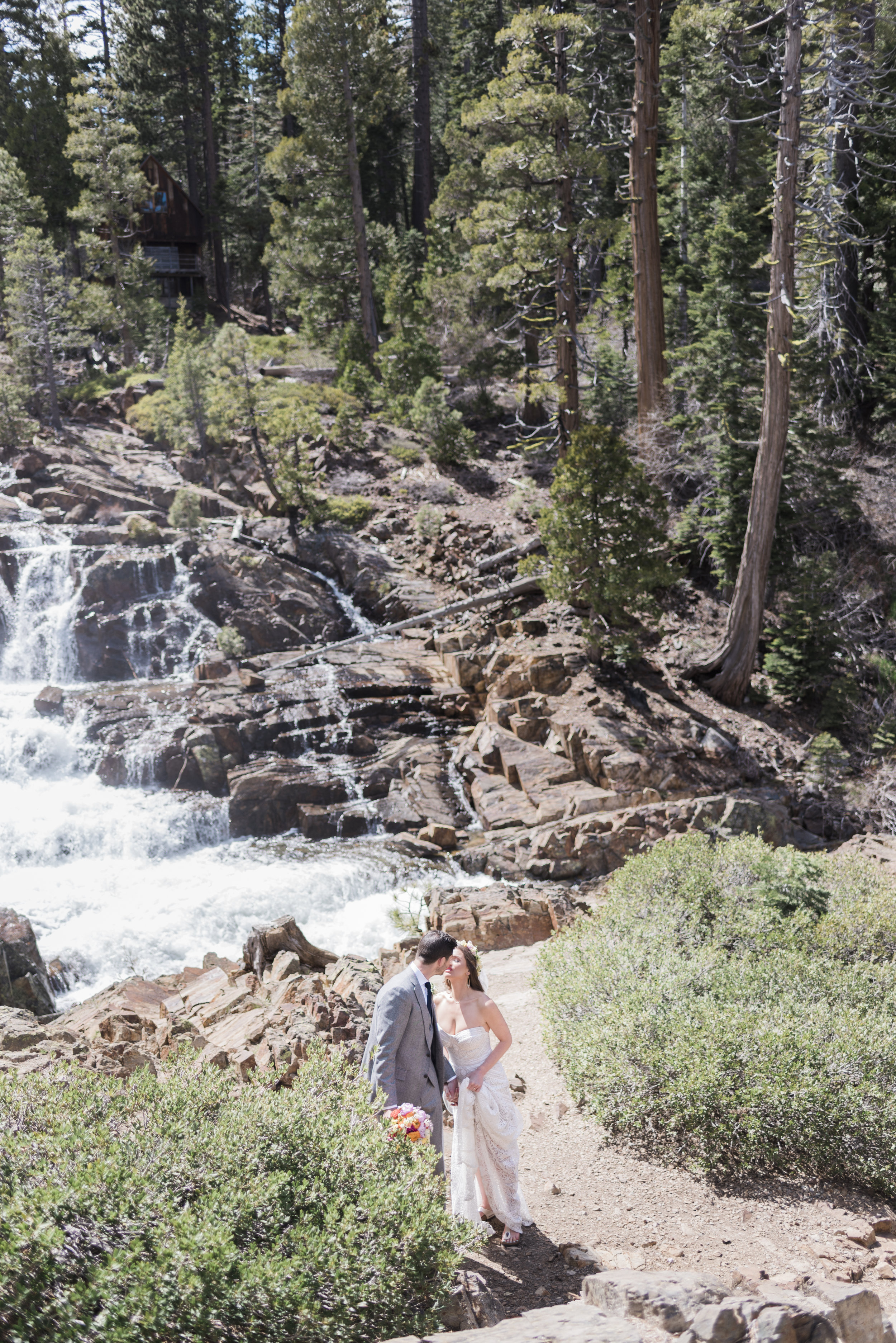 portrait-of-bride-and-groom's-first-look-by-a-waterfall.jpg