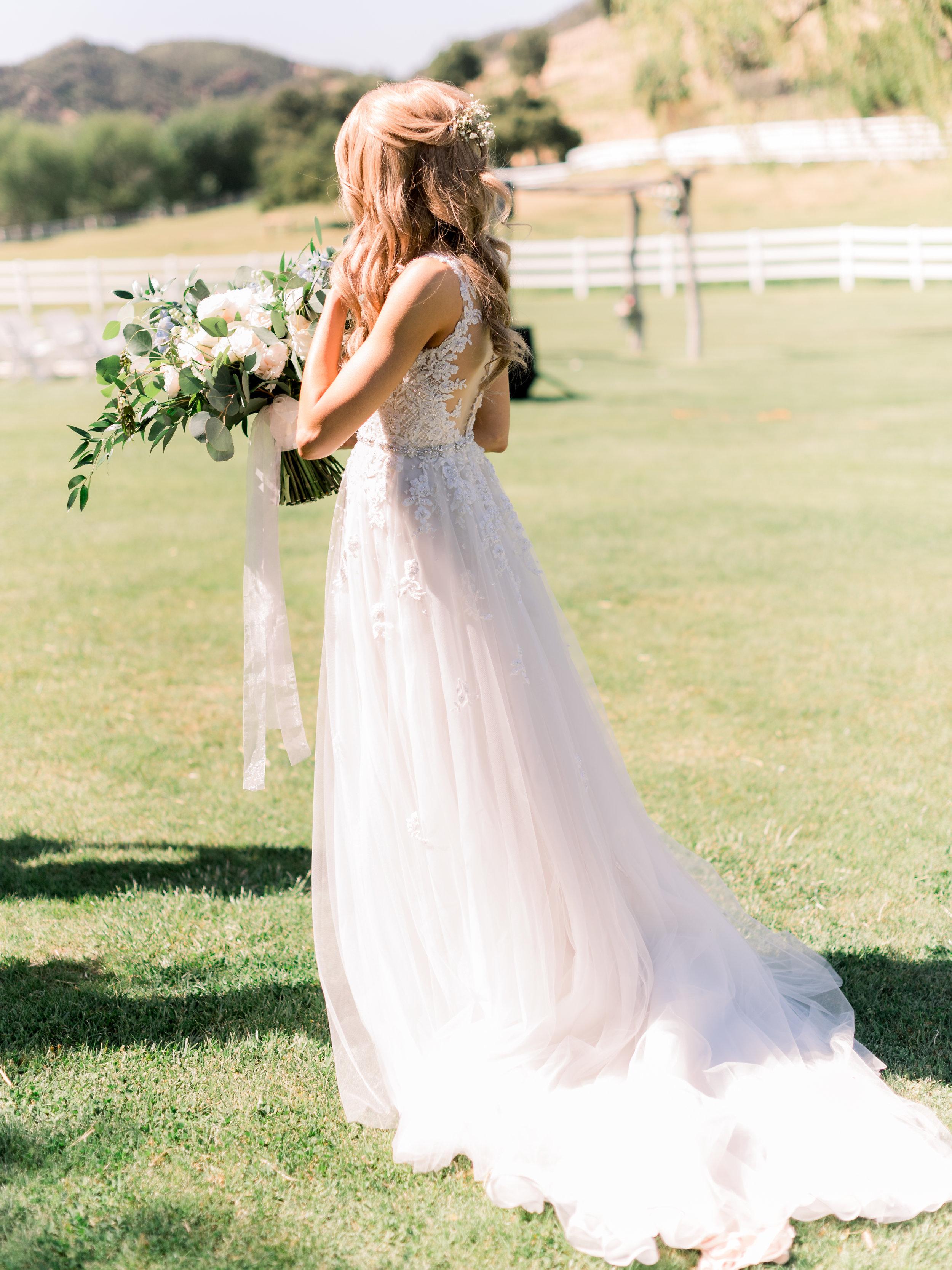 bride-walking-through-the-grass.jpg
