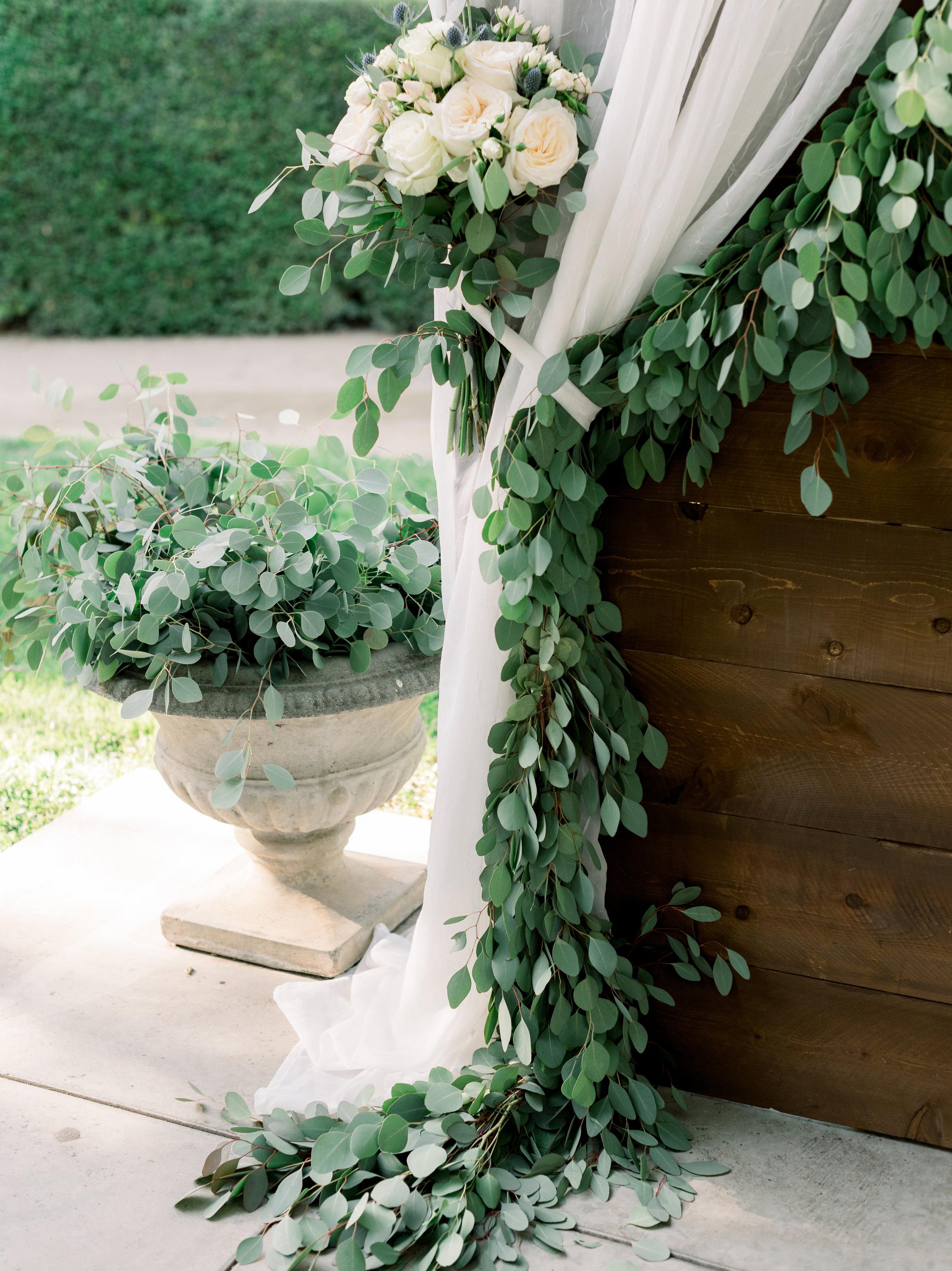 greenery-and-silk-wrapped-around-wedding-altar.jpg
