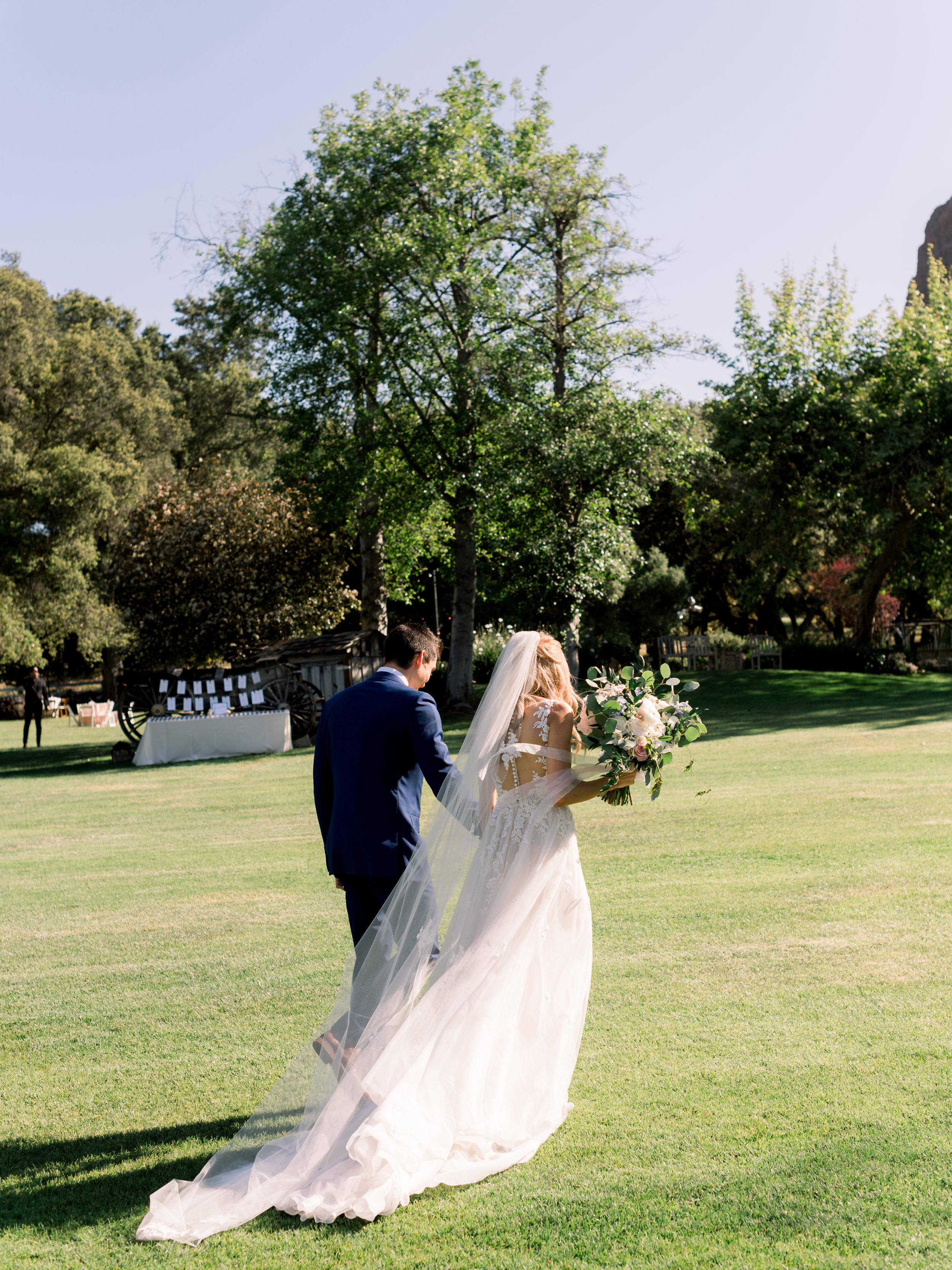 bride-and-groom-walk-hand-in-hand-after-the-ceremony.jpg