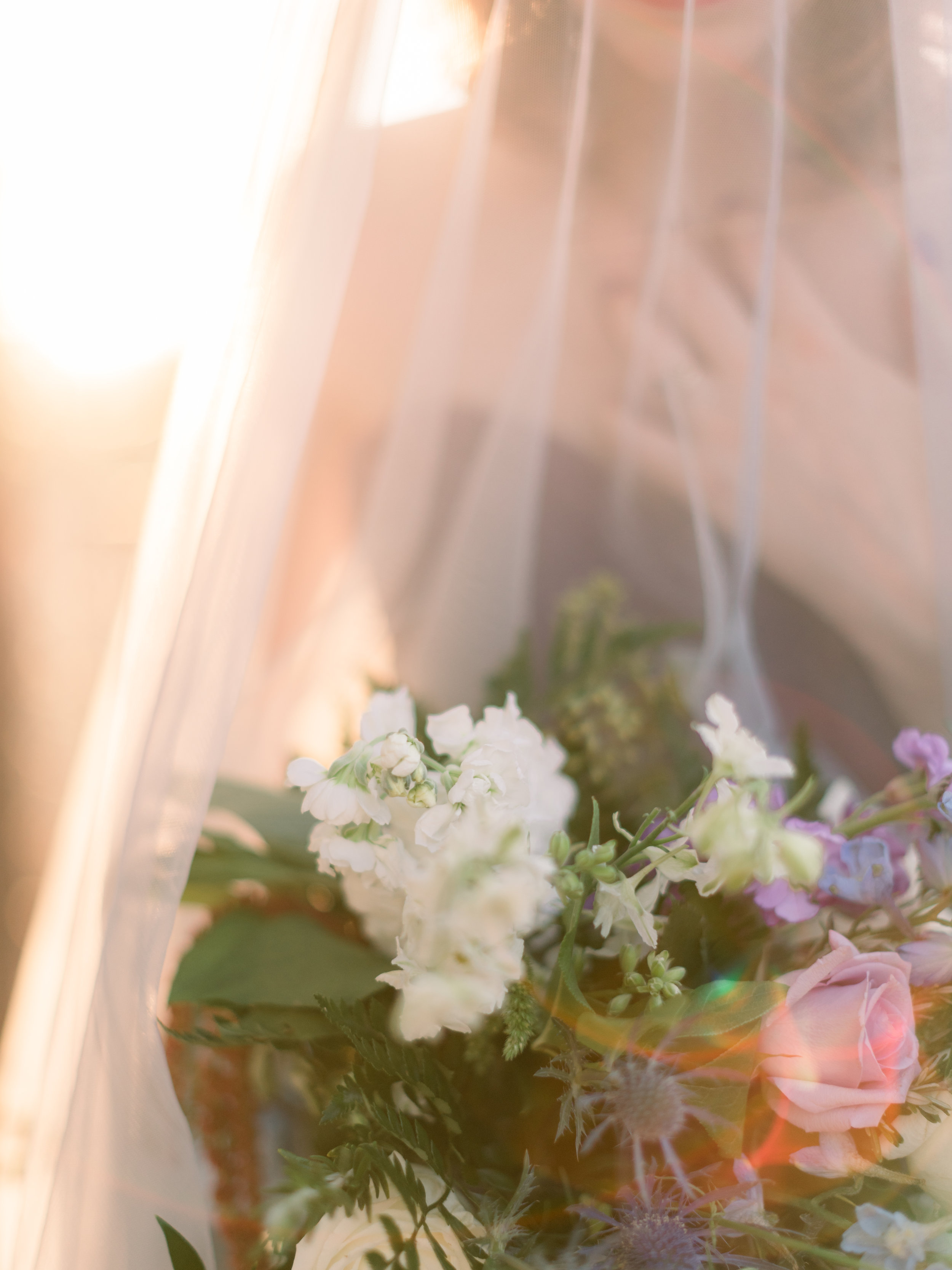 bridesmaid-holding-a-bouquet-at-sunset.jpg