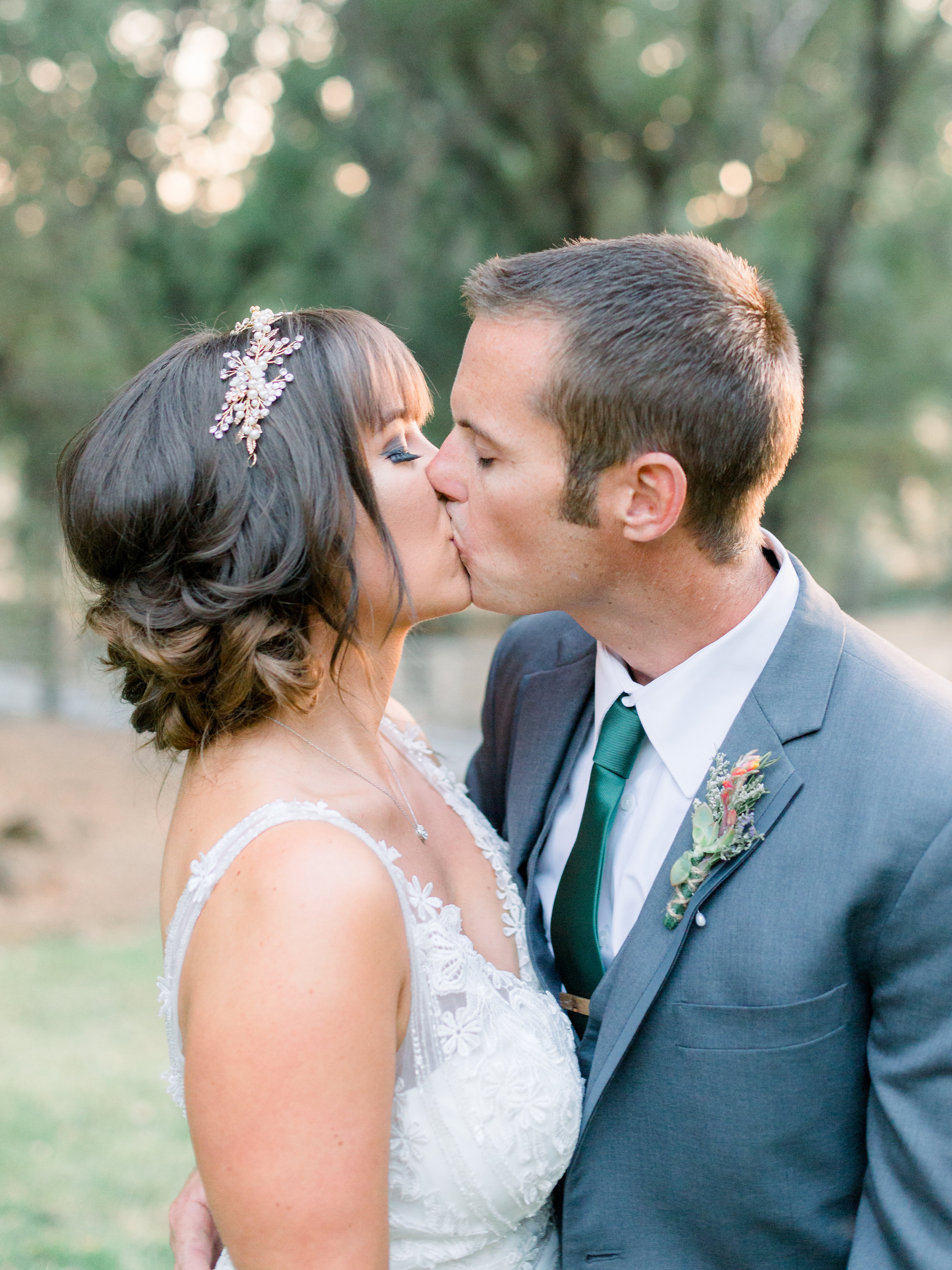 portrait-of-bride-and-groom-kissing-in-the-sunset.jpg