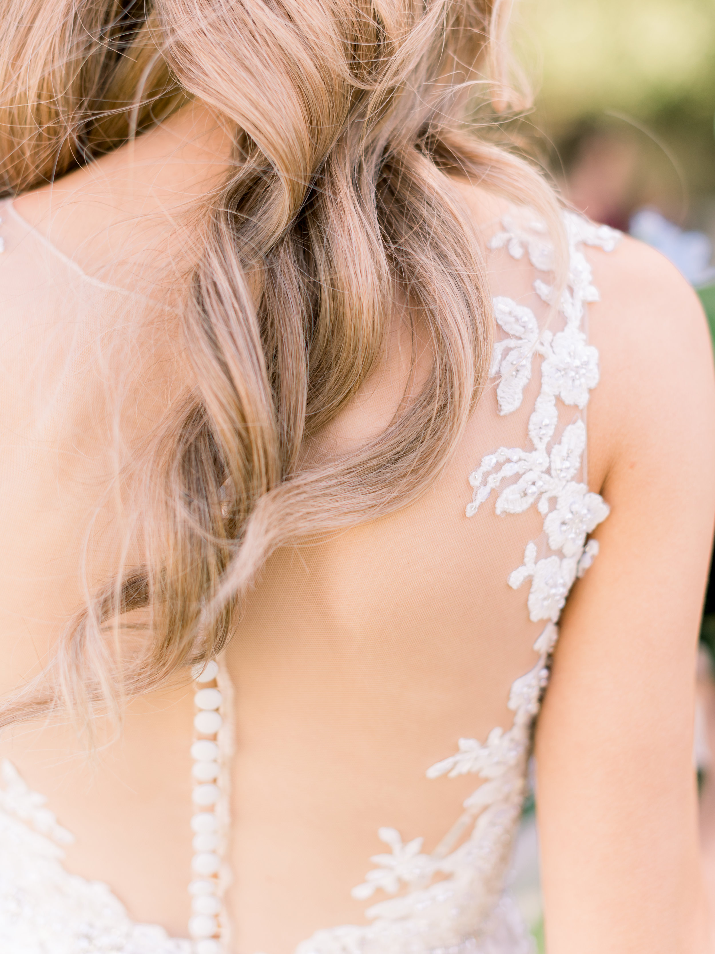 the-bride's-curls-trailing-down-her-back.jpg