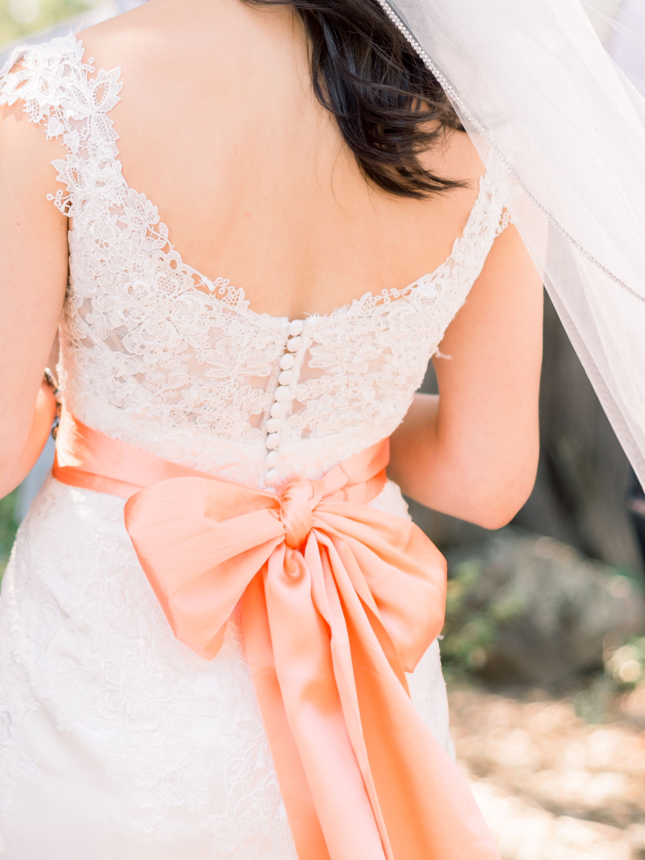 bride's-lace-wedding-gown-with-orange-bow.jpg