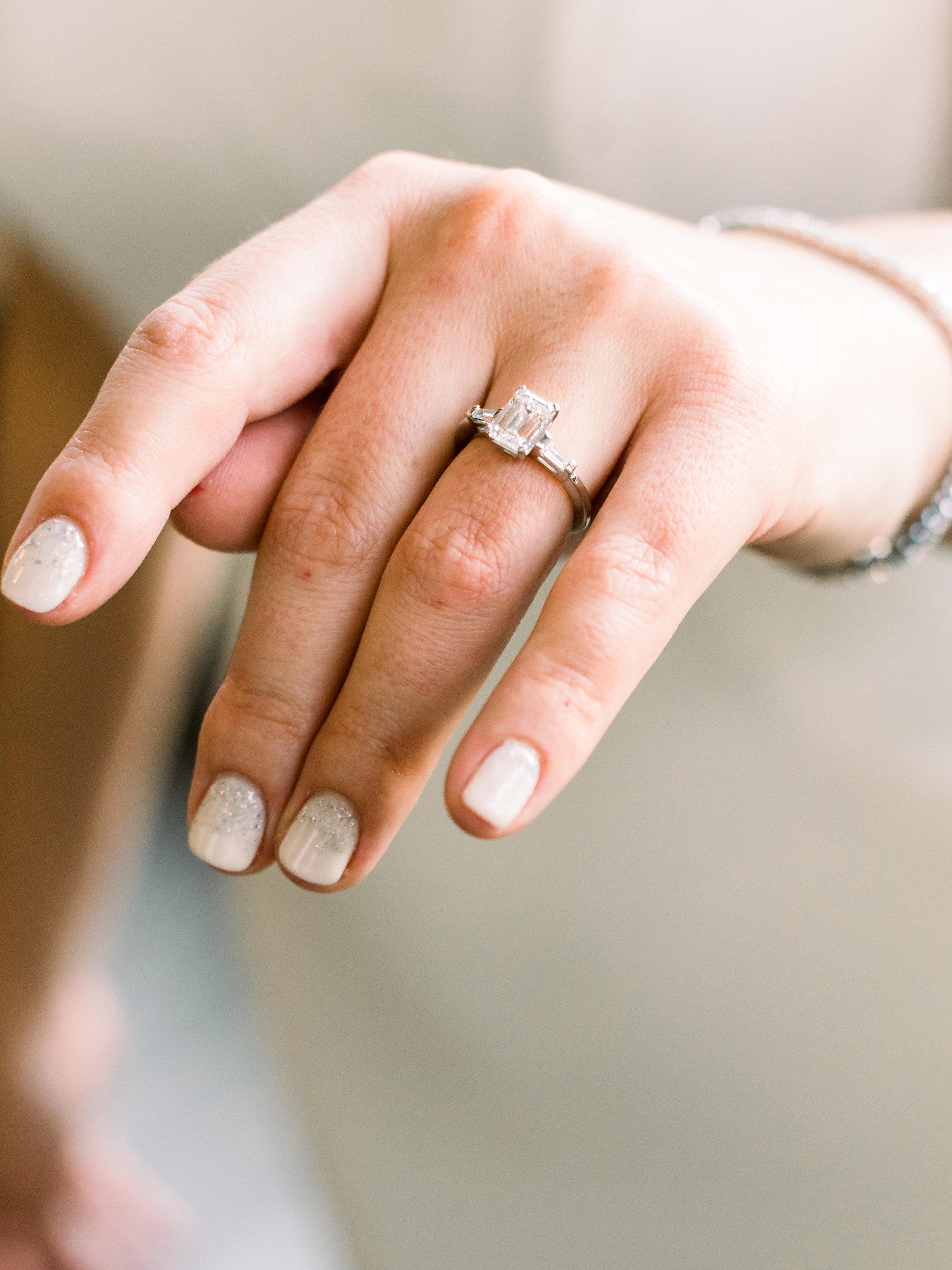 bride-showing-off-her-wedding-ring.jpg