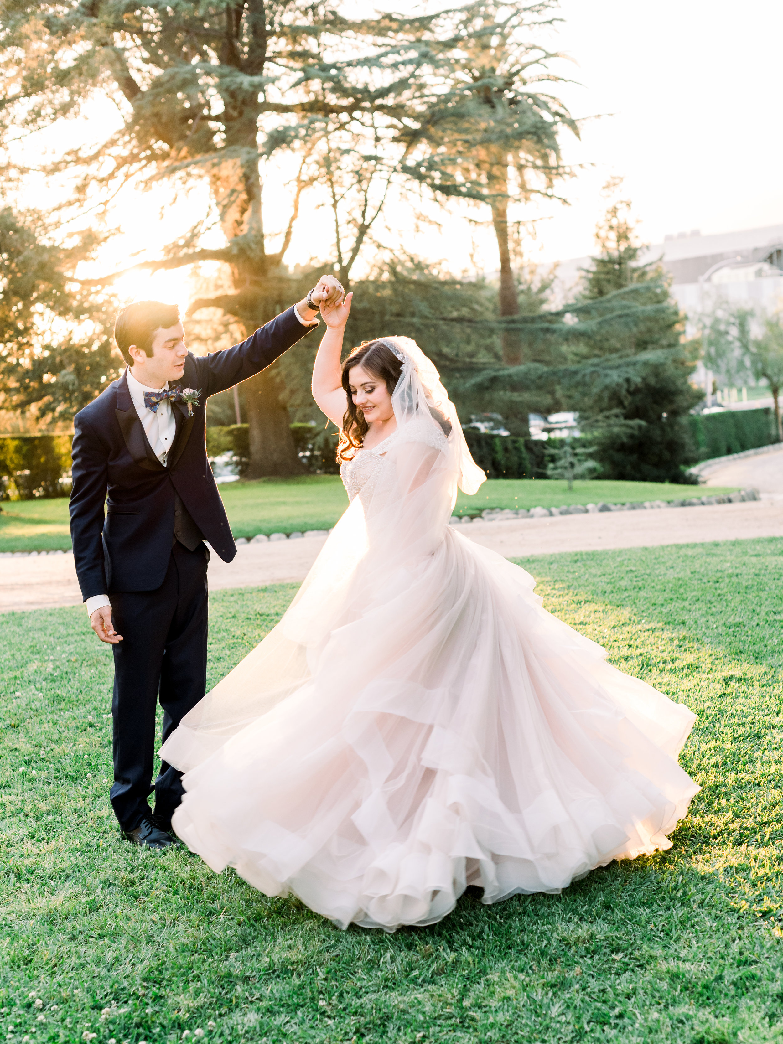 bride-and-groom-being-playful-in-the-sunset.jpg