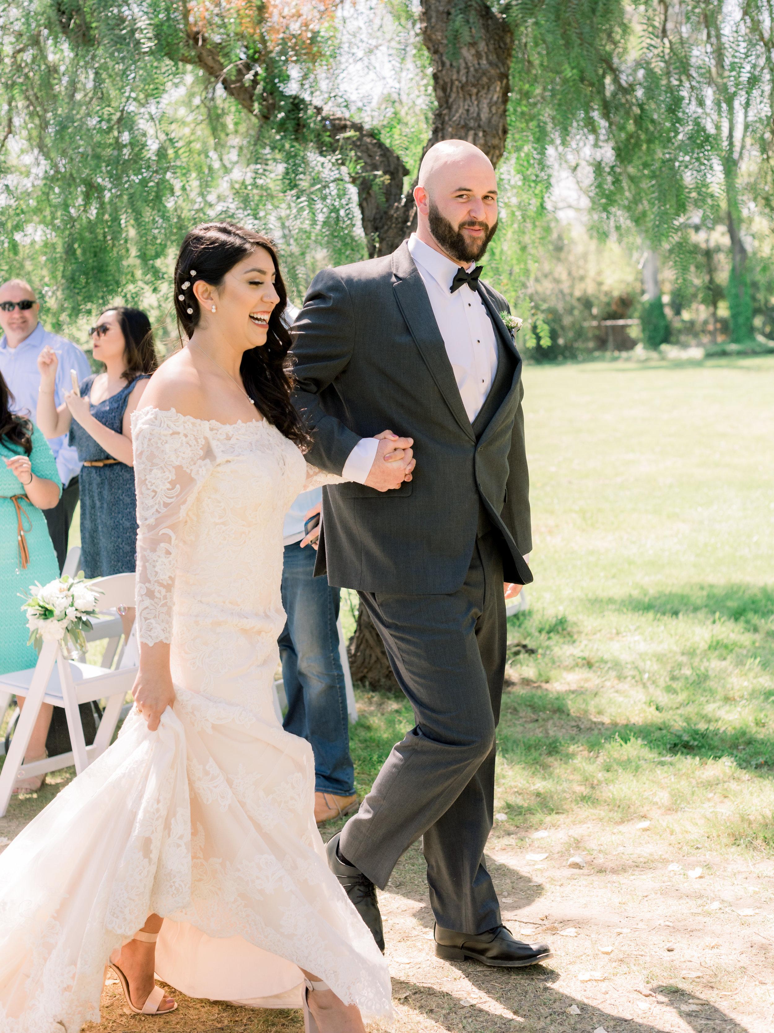 bride-and-groom-walk-back-down-the-aisle-just-married.jpg