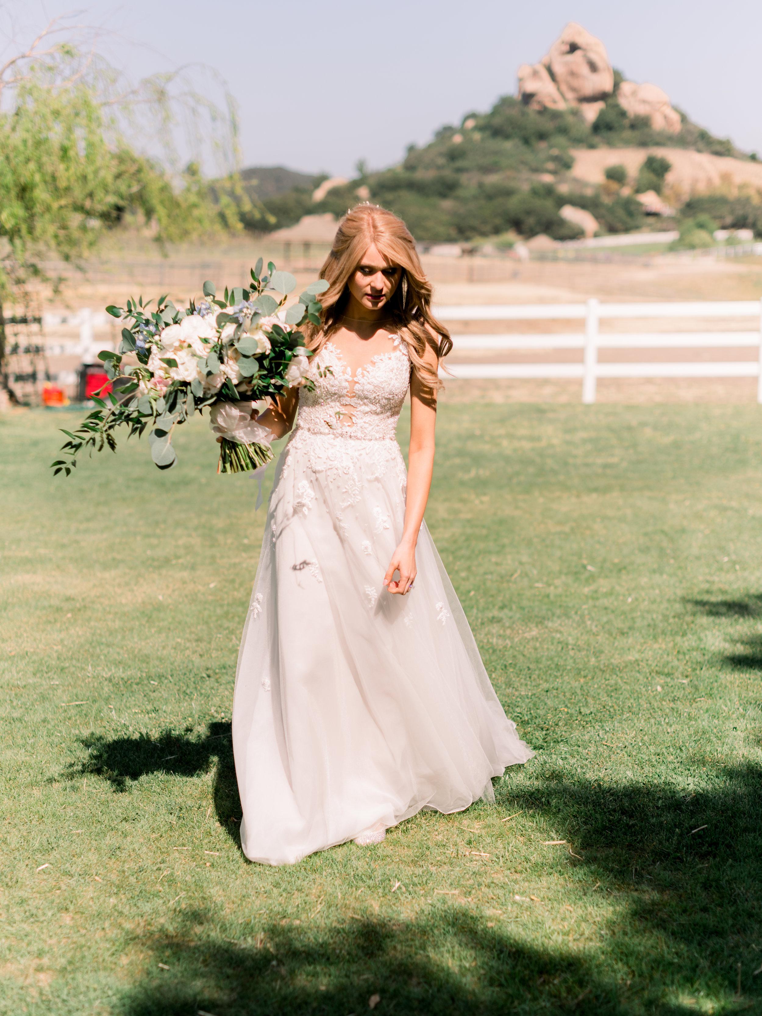 bride-strolling-through-the-wedding-venue-grounds.jpg