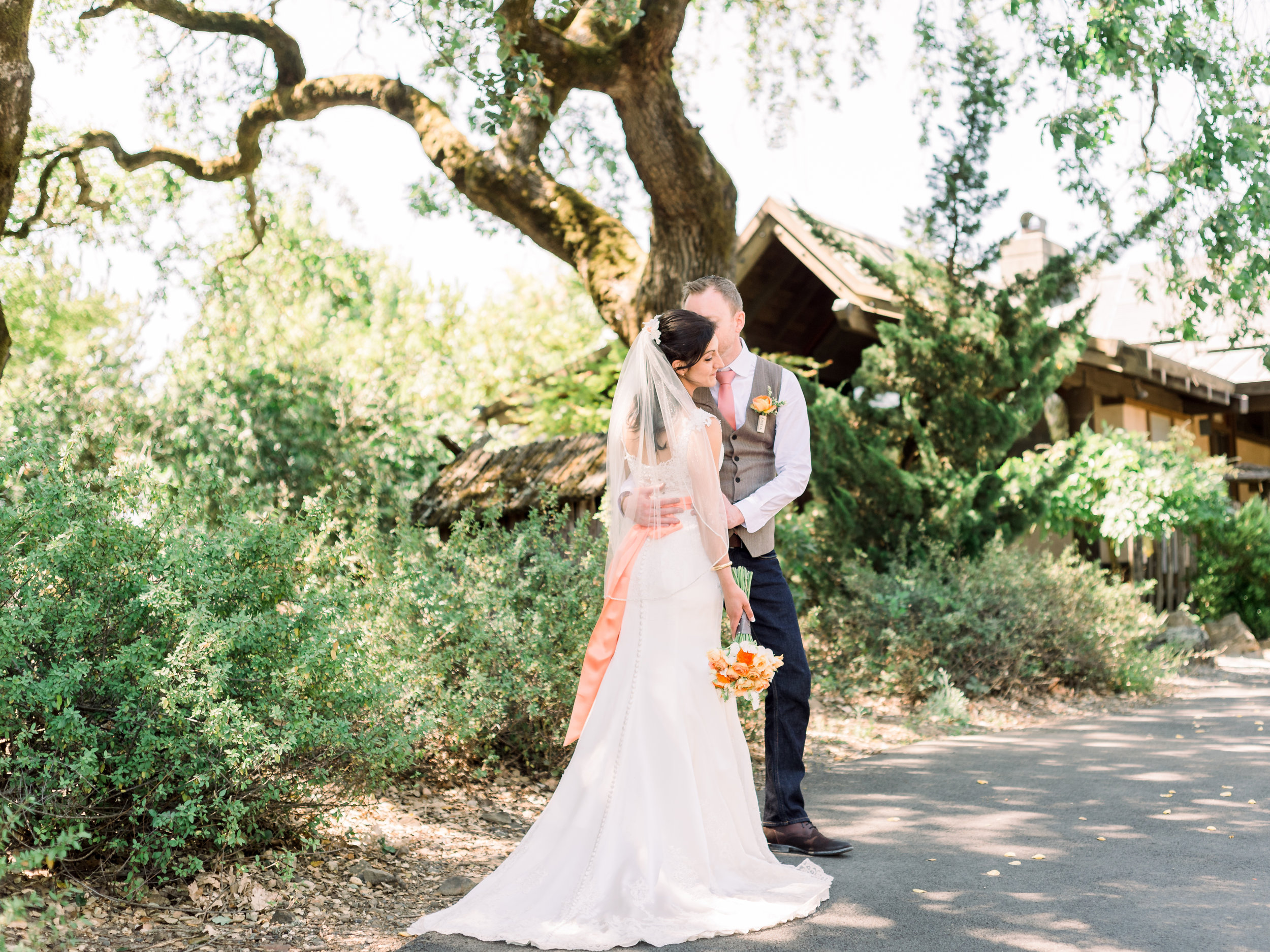 bride-and-groom-portrait-under-the-trees.jpg