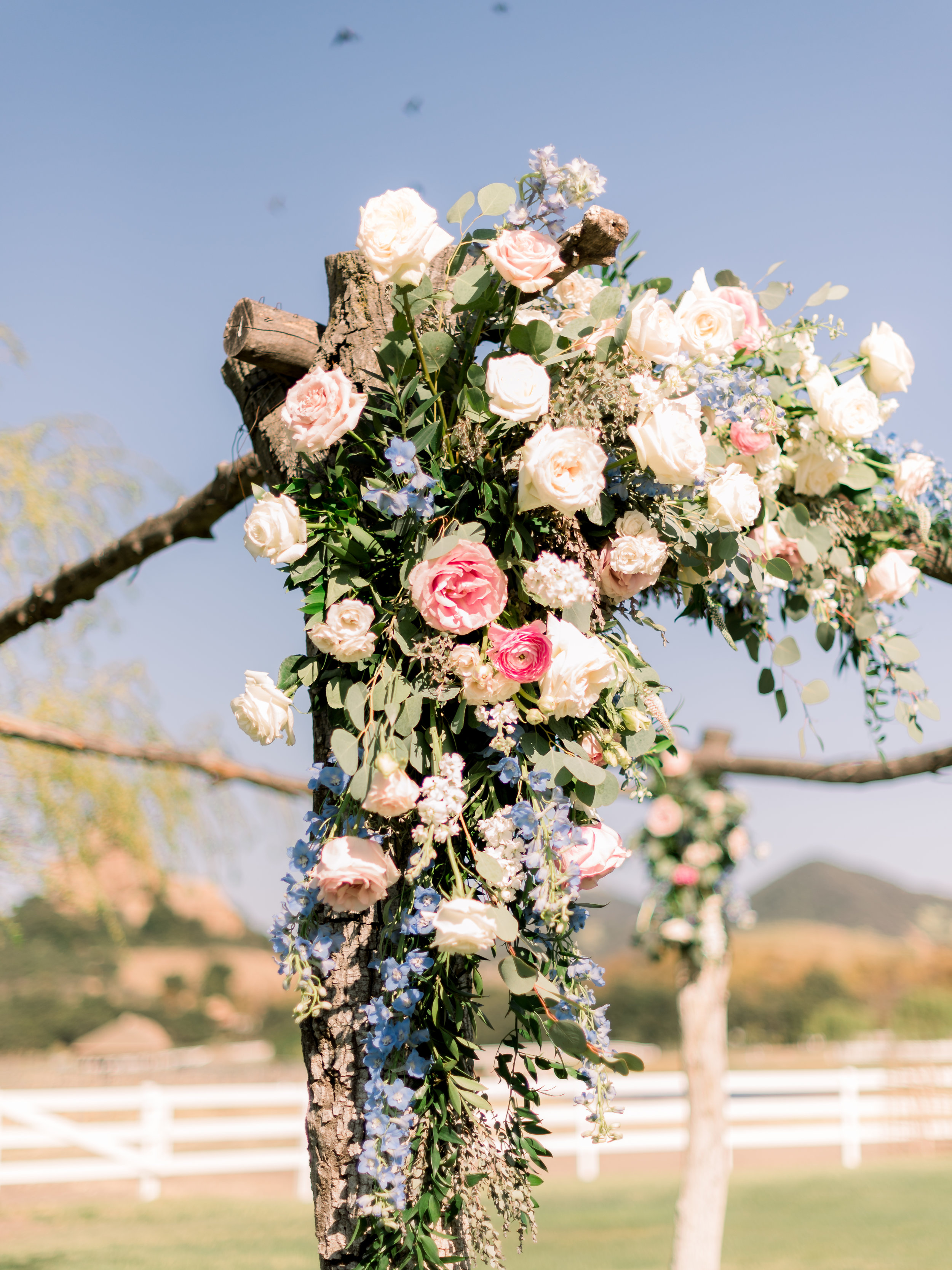 wedding-altar-draped-with-flowers.jpg