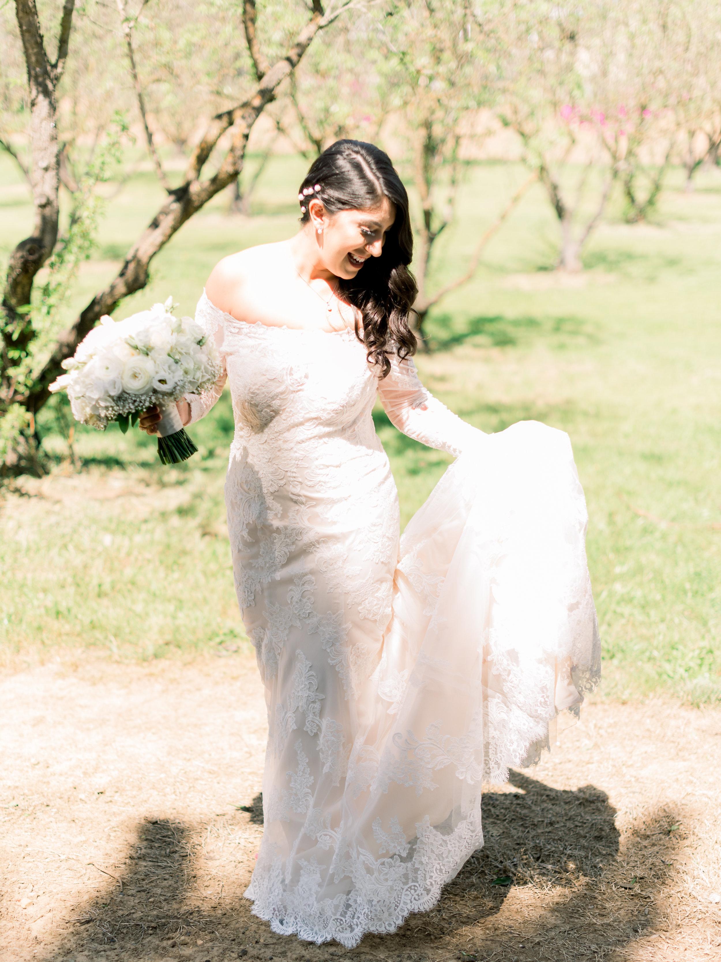 the-bride-being-playful-in-the-vineyard.jpg
