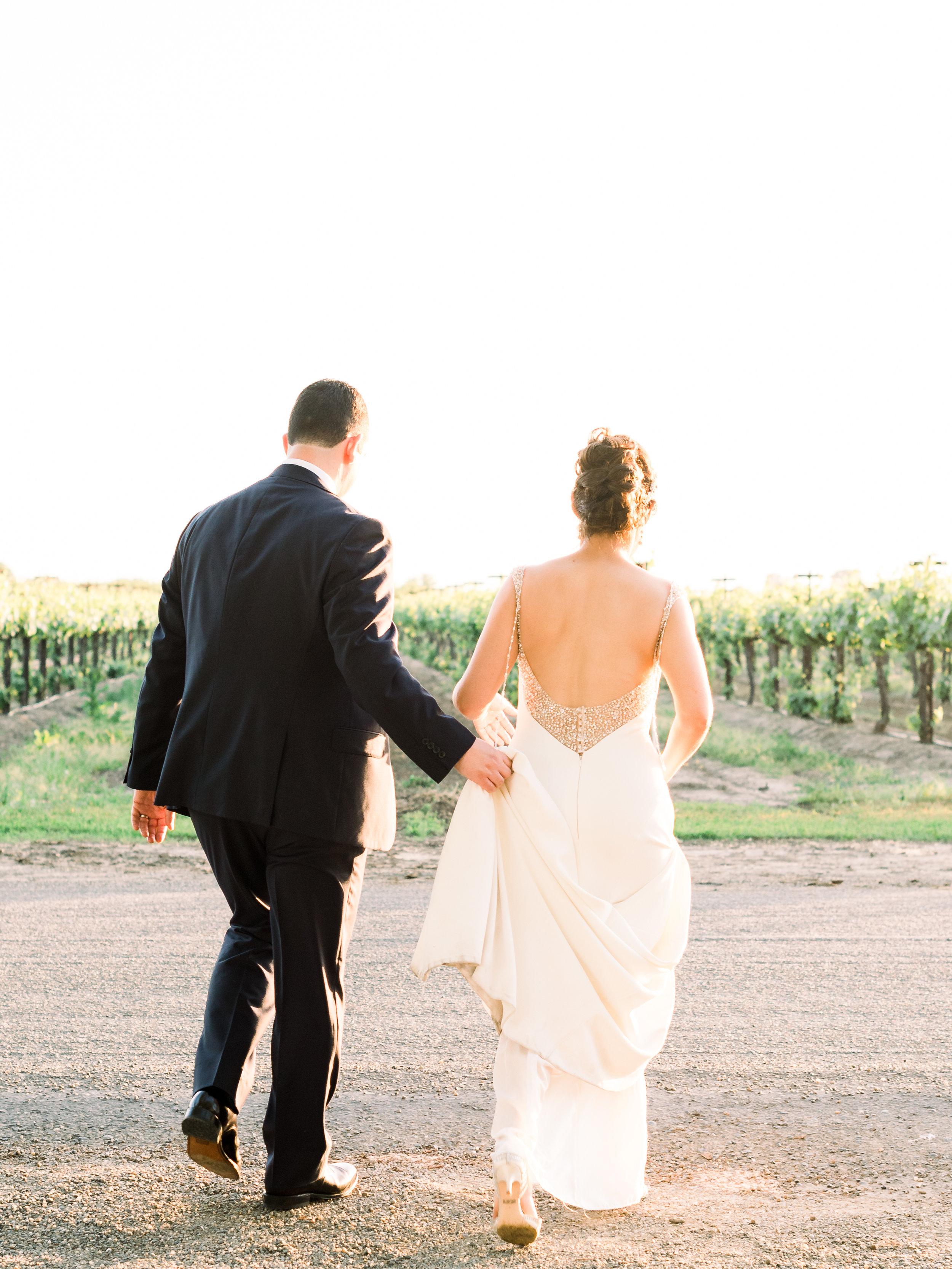 bride-and-groom-walking-to-the-vineyards.jpg