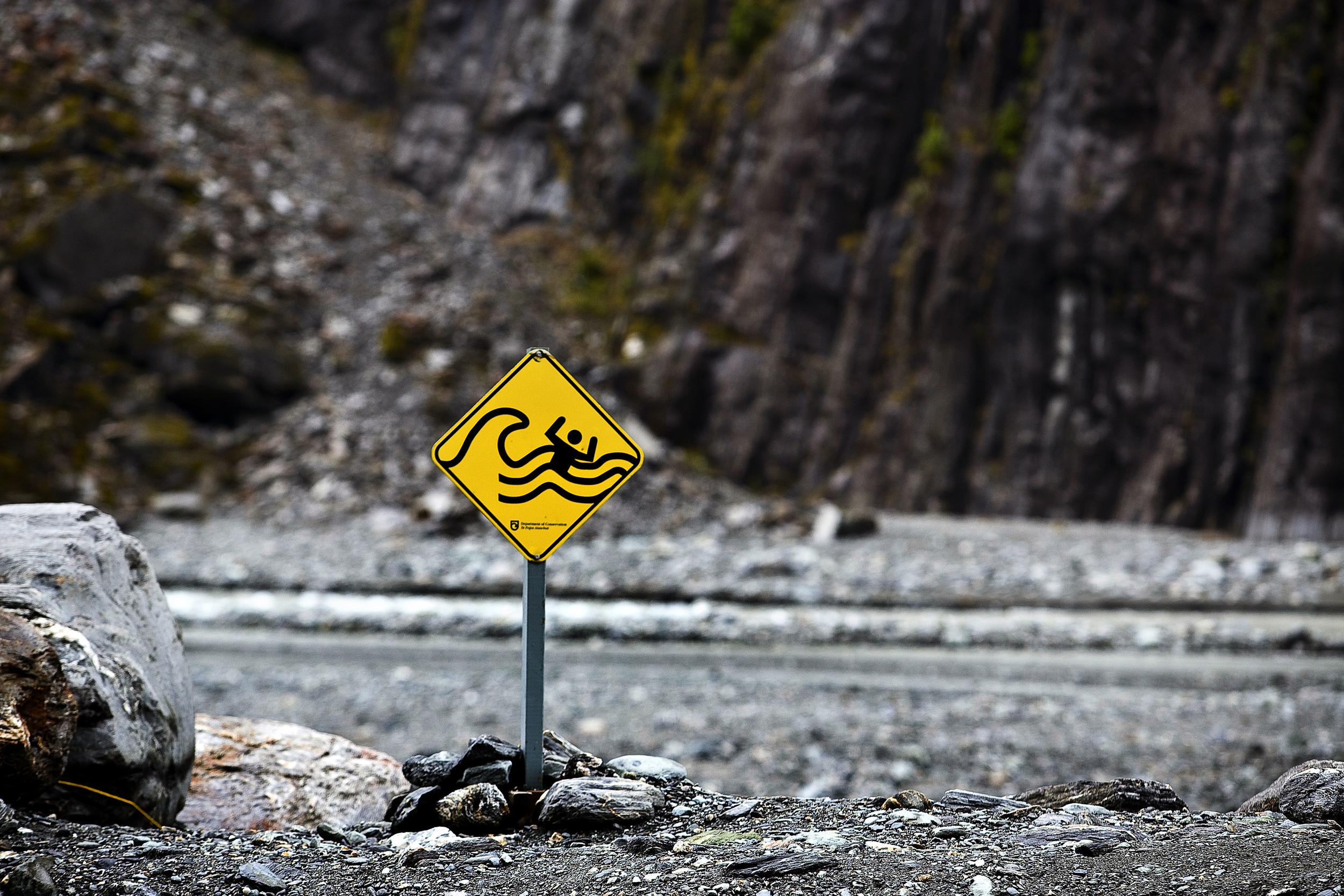 Misinterpreted signs at the base of Fox Glacier.