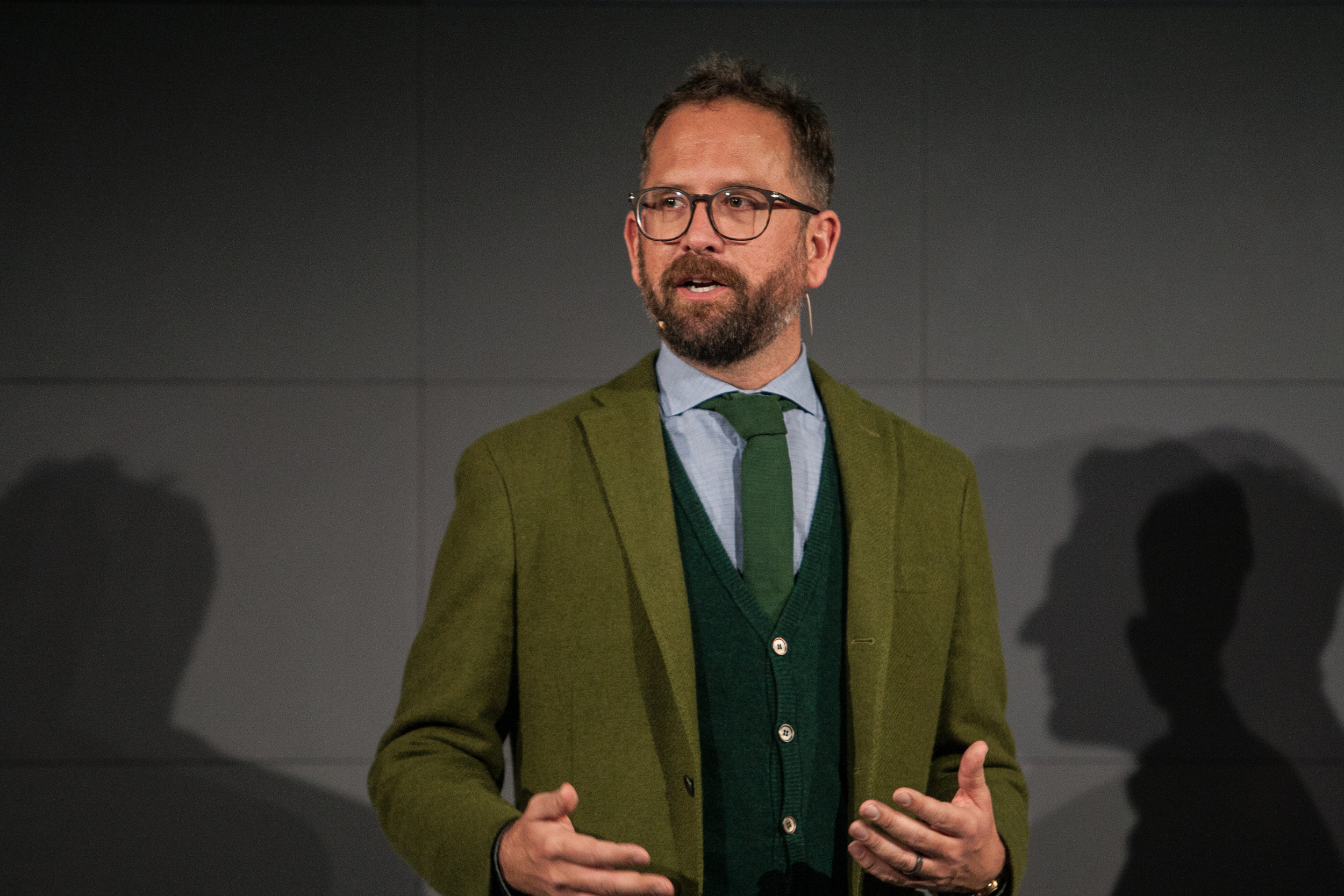 Slipstream CEO Jonathon Vaughters was the best dressed in the room, and as expected with plenty of green to show.