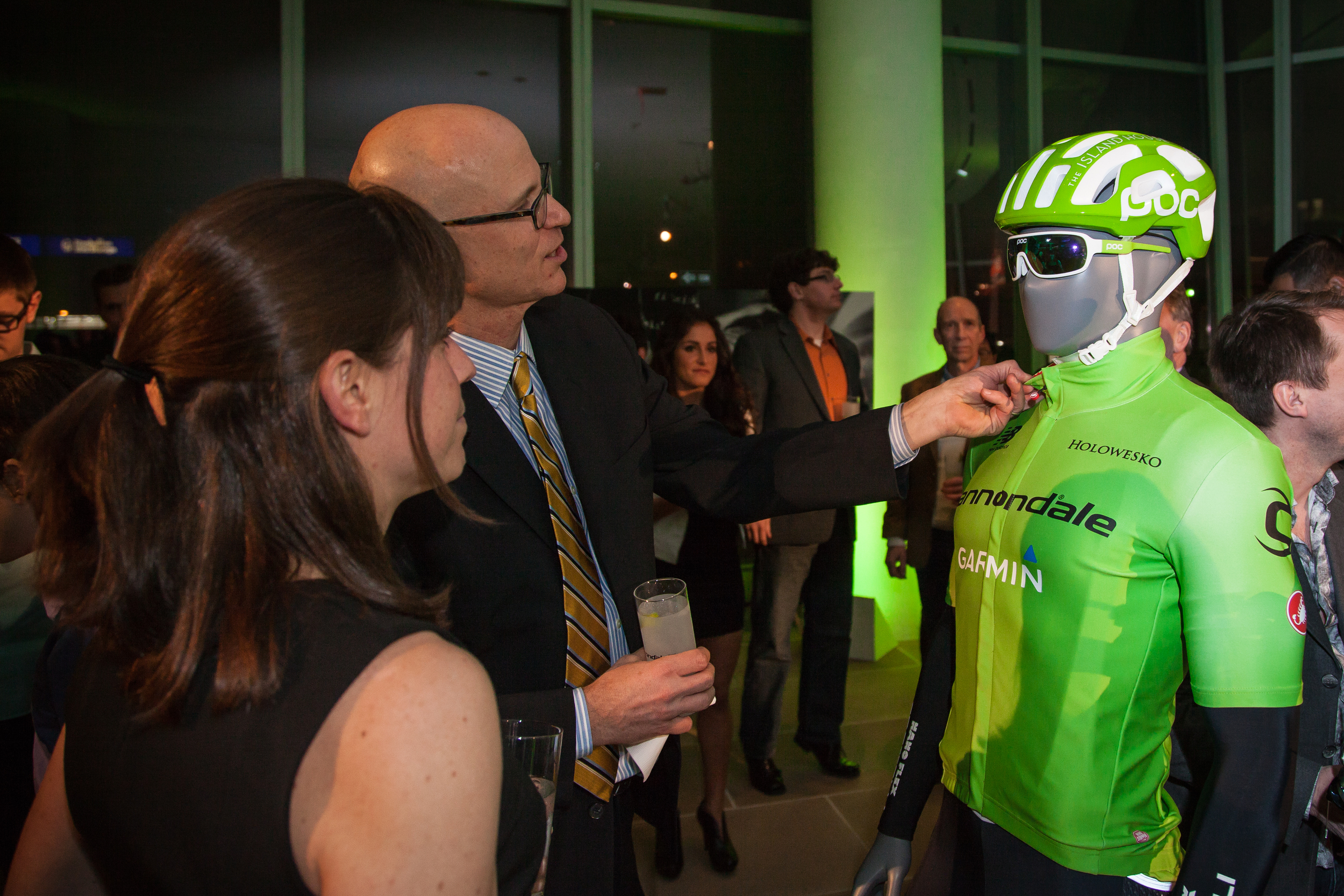 A guest inspects the new green kit for the Cannondale-Garmin Pro Cylcing team at the NYC launch event.
