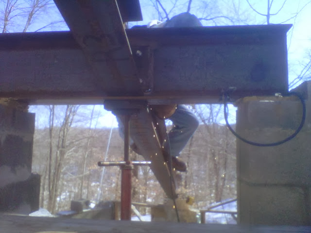 John Tunstead, Tunstead Welding, welds main roof beams to the stairway lintel.  Temporary support jack borrowed from neighbors Pete & Darlene Fisher.